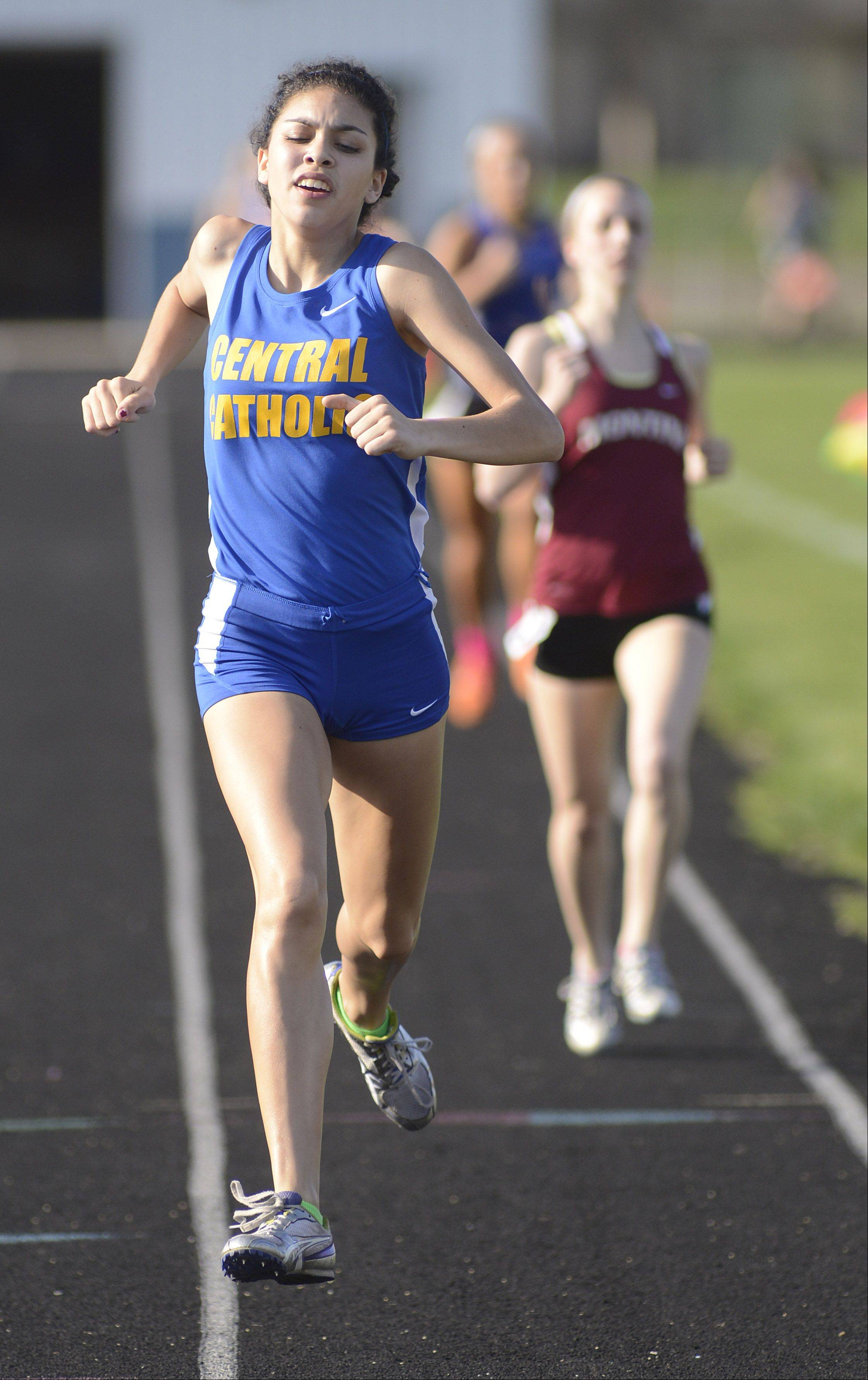 Aurora Central Catholic's Karina Liz takes first place in the second heat of the 800 meter run at the Suburban Christian Conference on Wednesday, May 1.