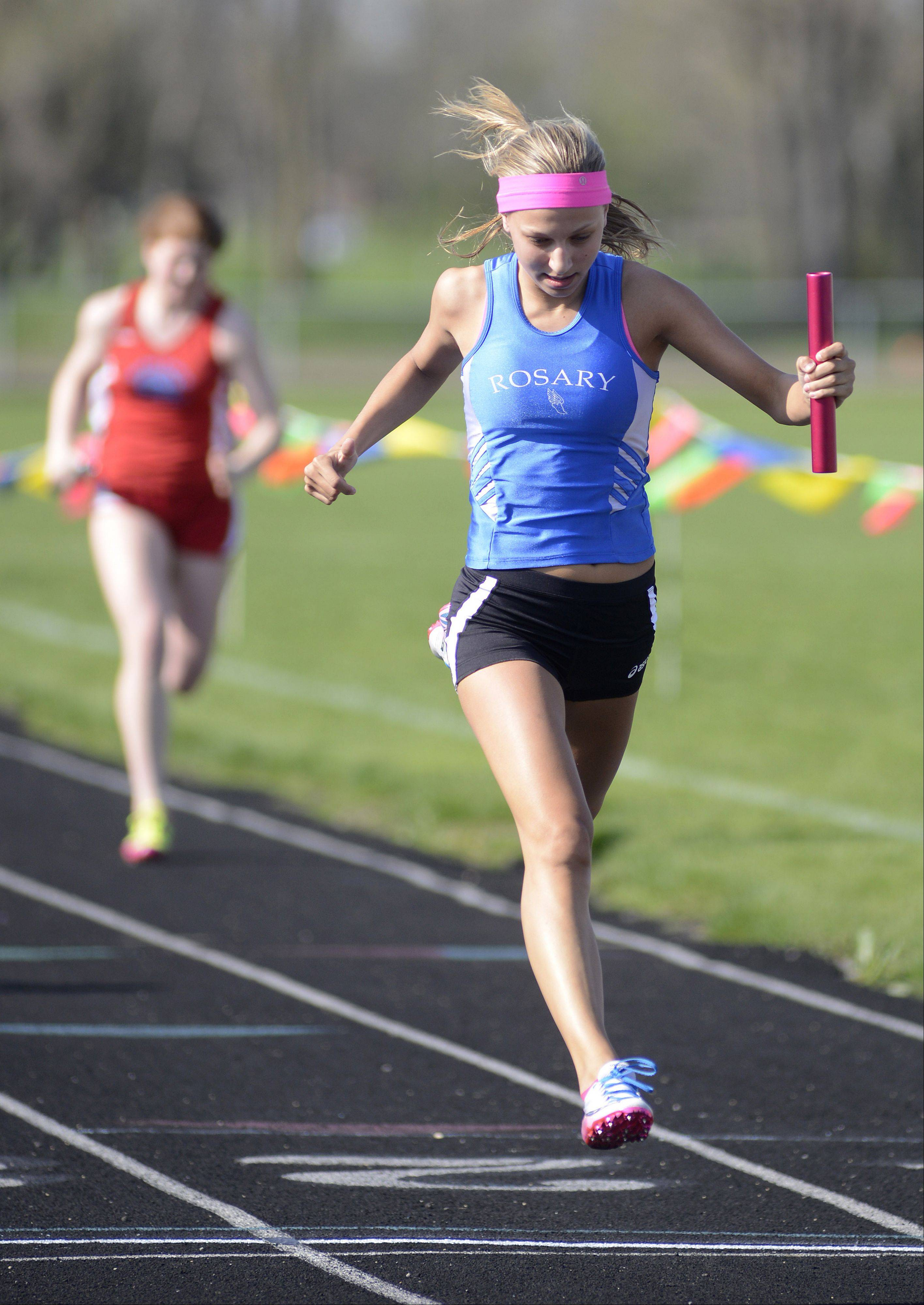 Molly Stefanski helps the Royals take second pace in the second heat of the 4 x 100 relay at the Suburban Christian Conference on Wednesday, May 1.