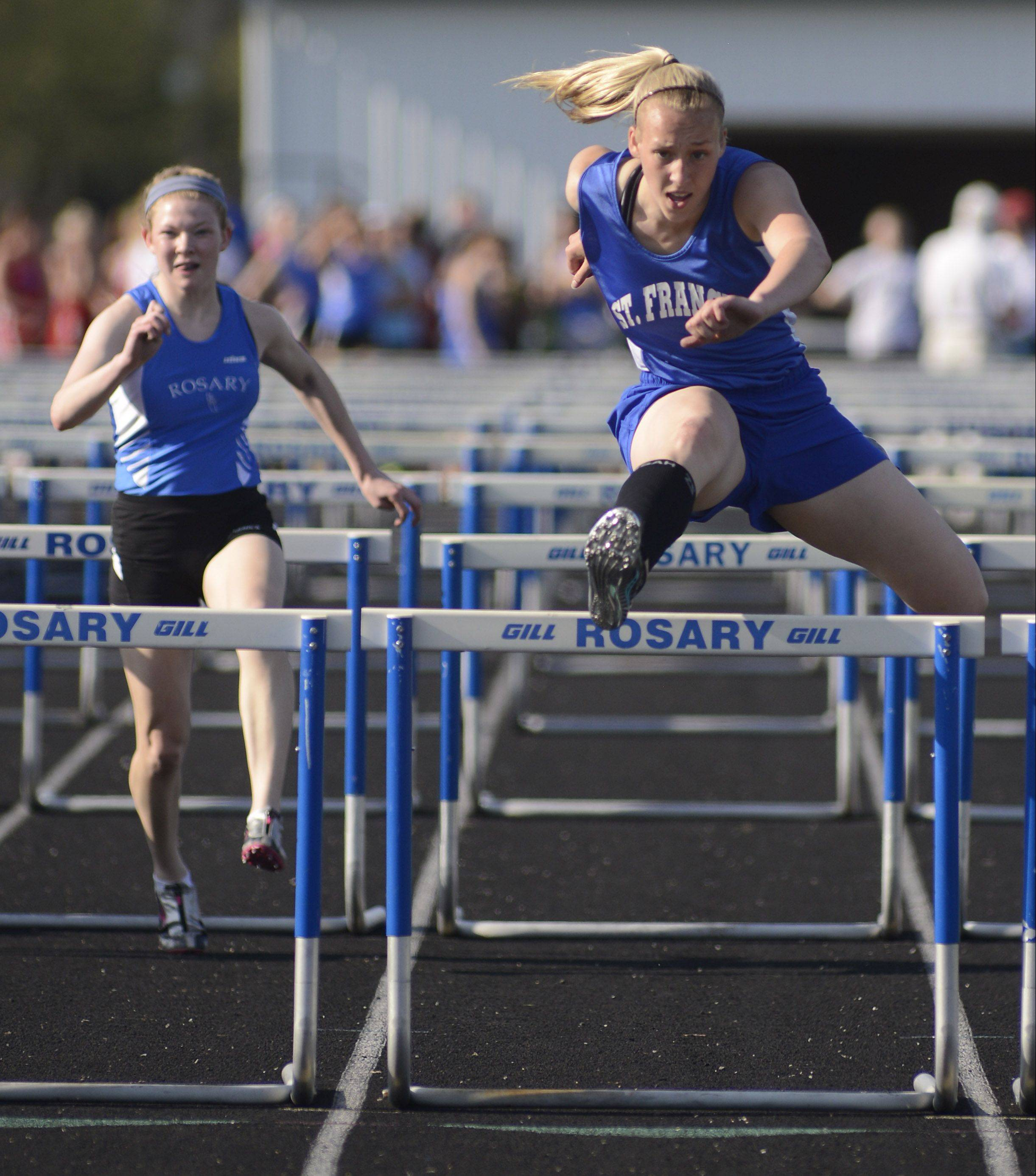 St. Francis' Amanda Nunley clears a hurdle Wednesday in Aurora.
