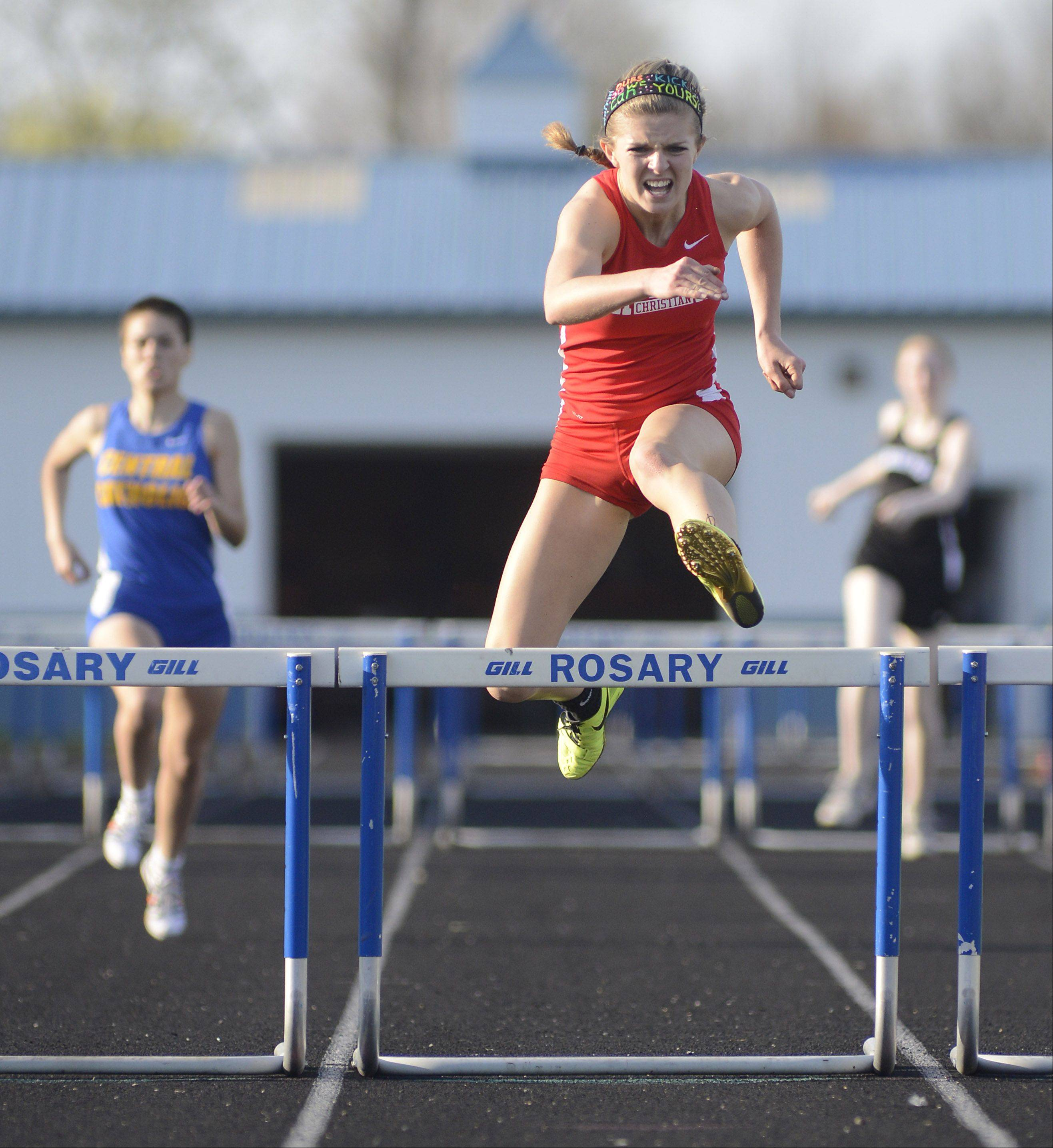 Aurora Christian's Taylor Eaves wins the second heat of the 300 meter hurdles at the Suburban Christian Conference on Wednesday, May 1.