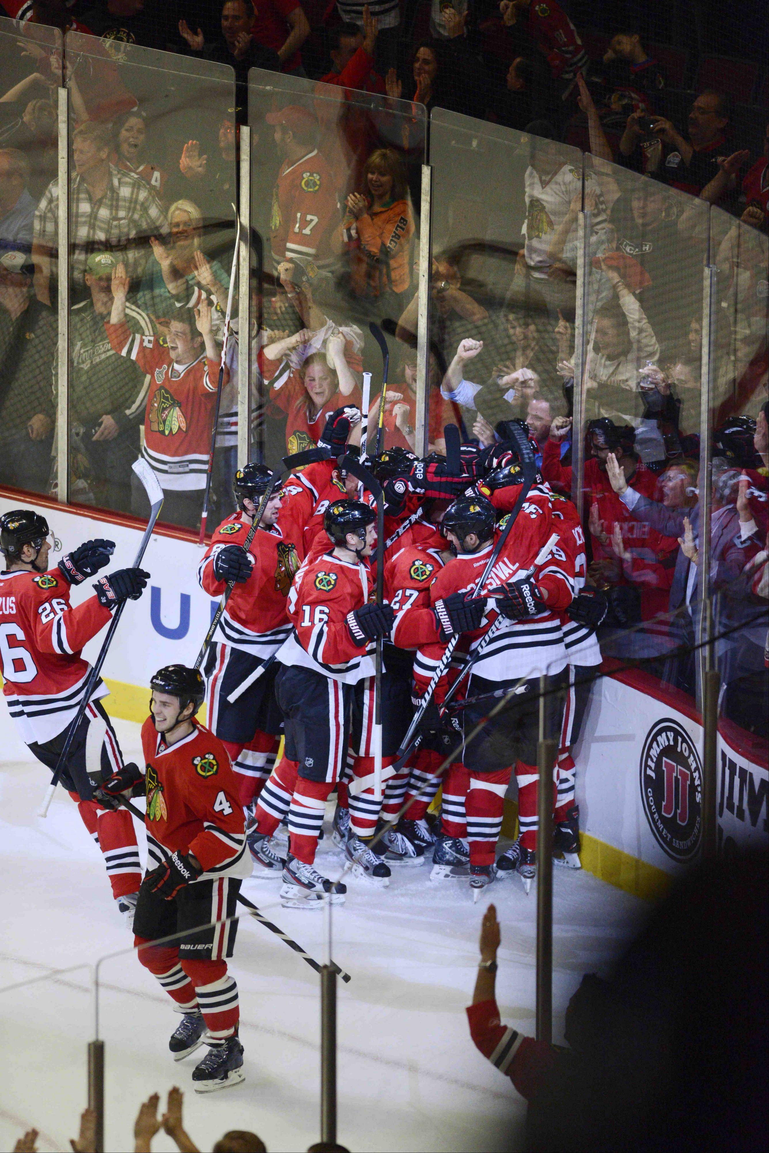 Defenseman Johnny Oduya's long off-the-glass pass in overtime set up this Game 1 celebration at the United Center.