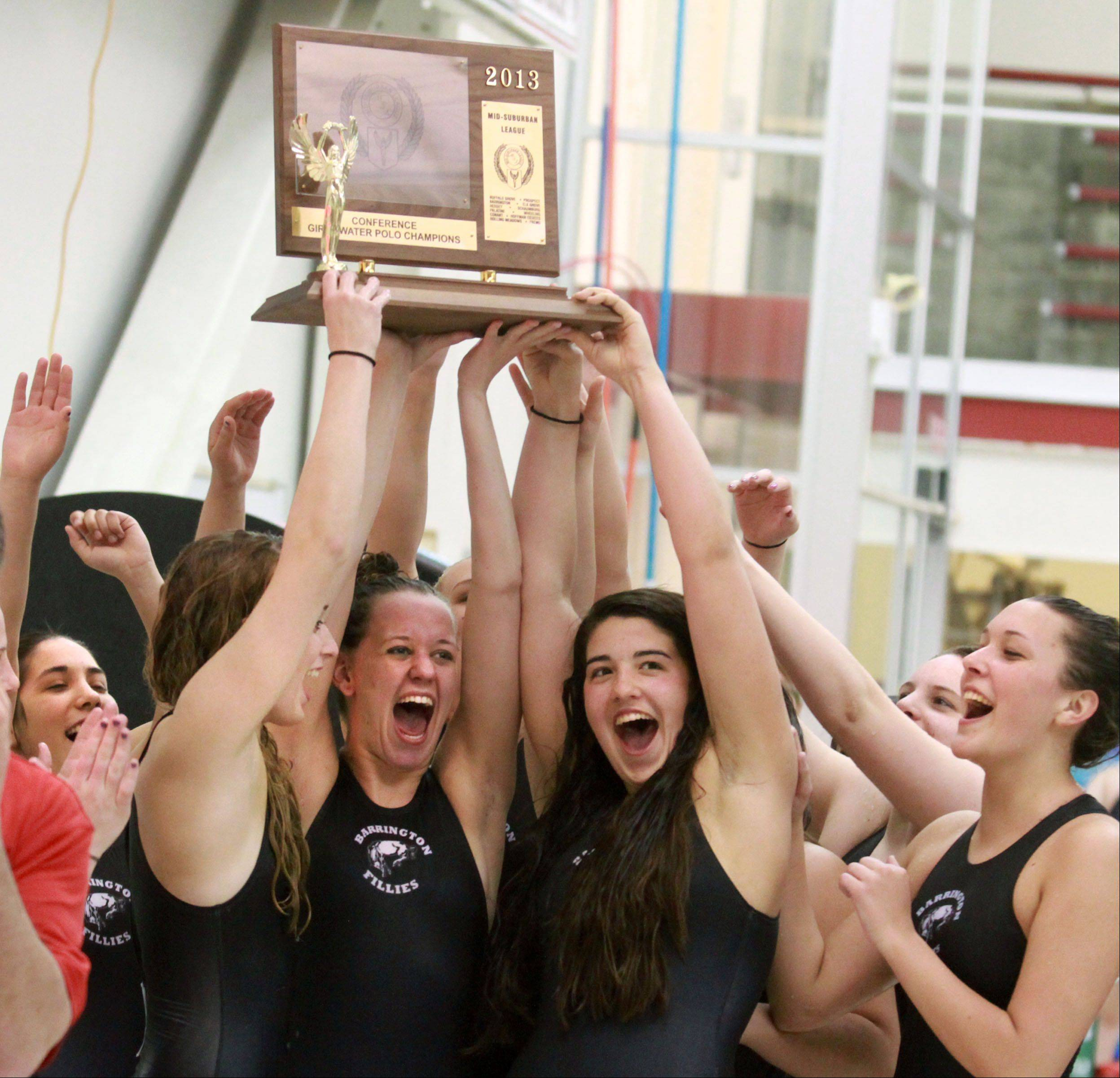 Barrington celebrates with the MSL championship plaque after topping Hersey 8-6 at Barrington on Wednesday.