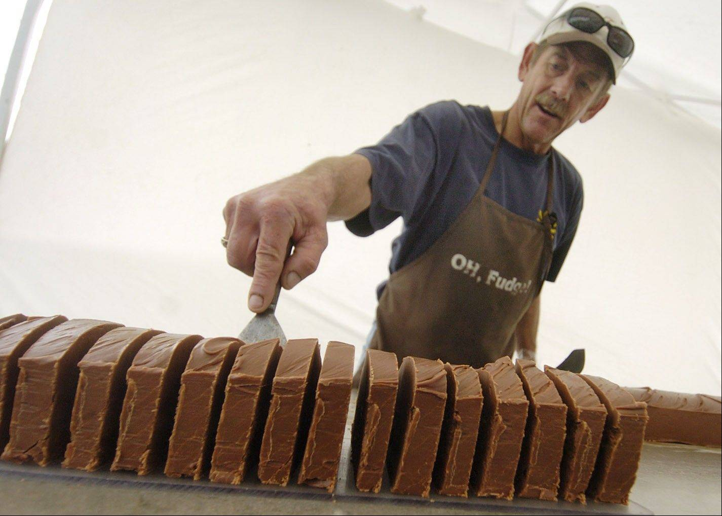Bob Brown of Oh Fudge from Flemington, Mo., slices up his homemade fudge at last year's fest.