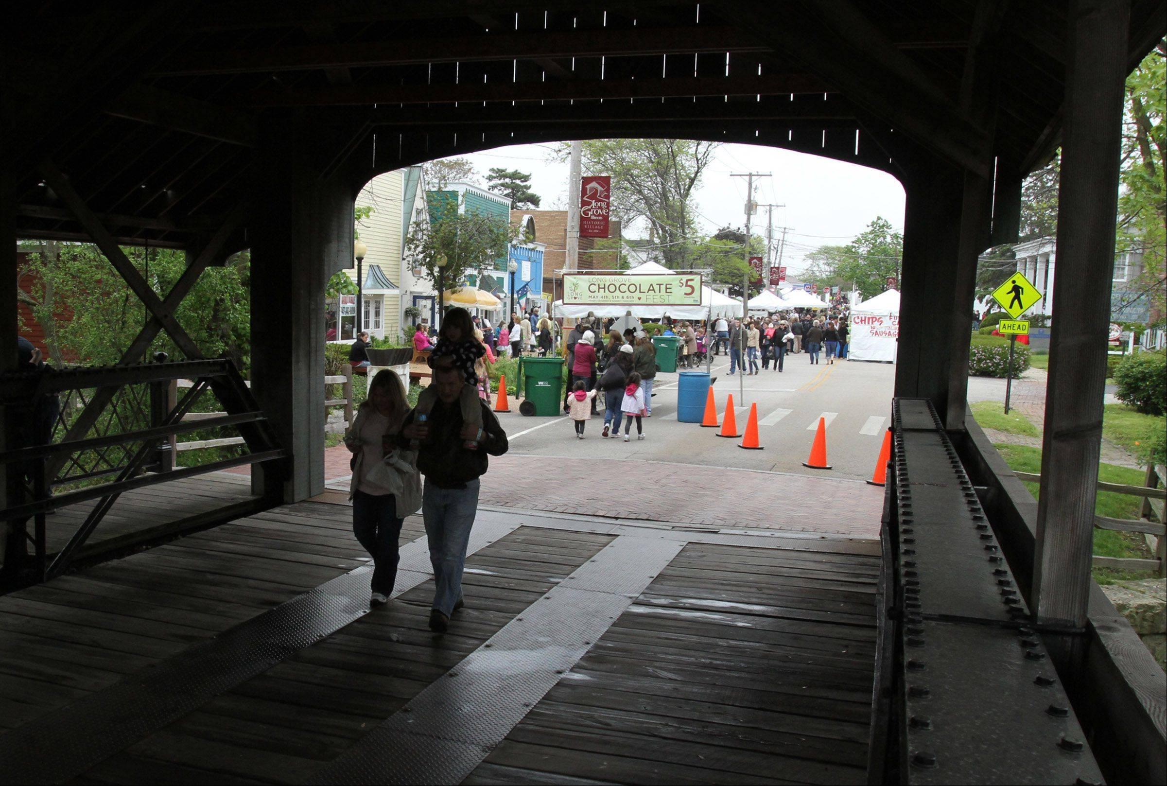 Fest goers enter the Long Grove Chocolate Fest through the covered bridge.