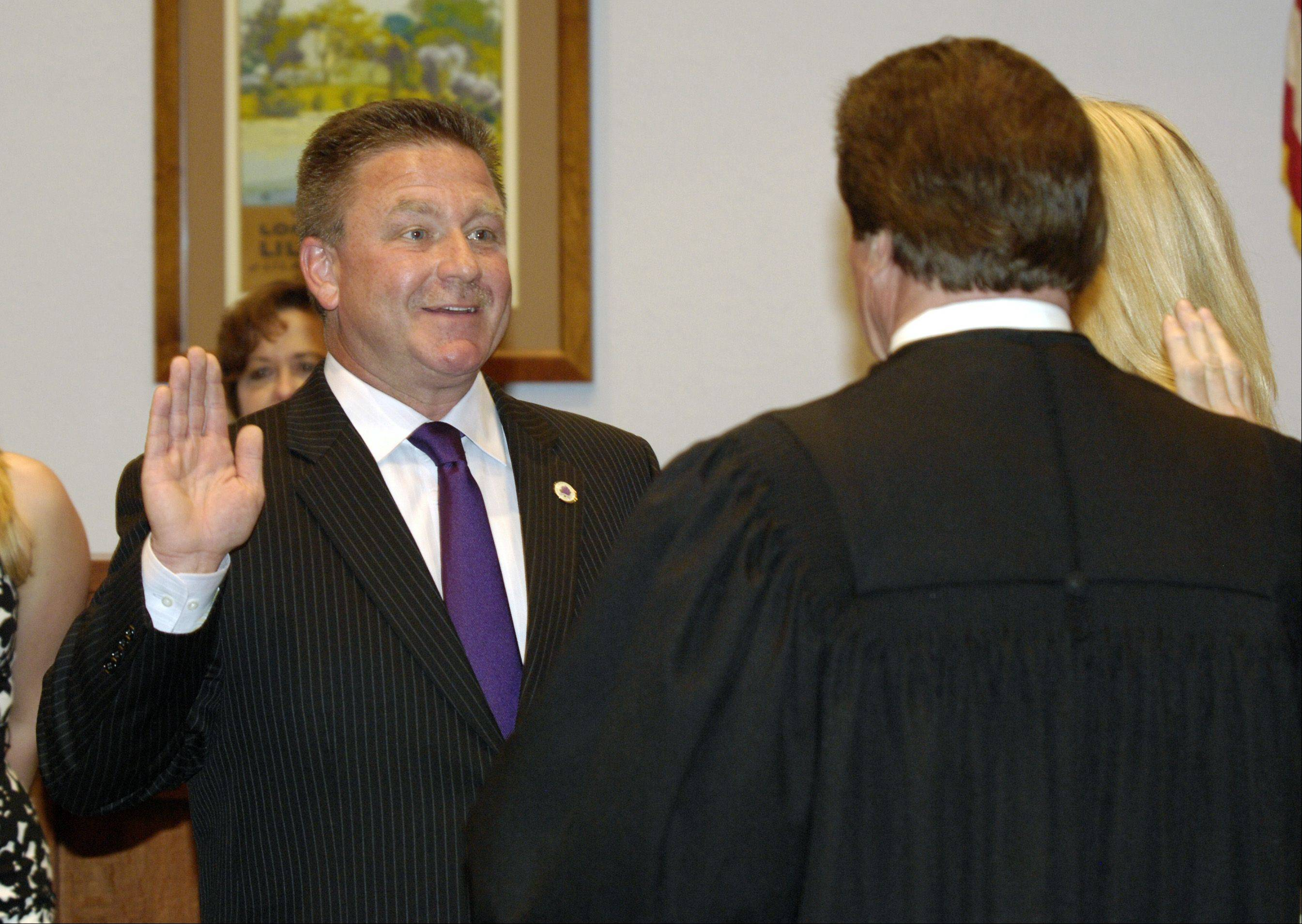 Keith Giagnorio is sworn in Thursday night as the new Lombard village president by DuPage County Judge Patrick O�Shea.