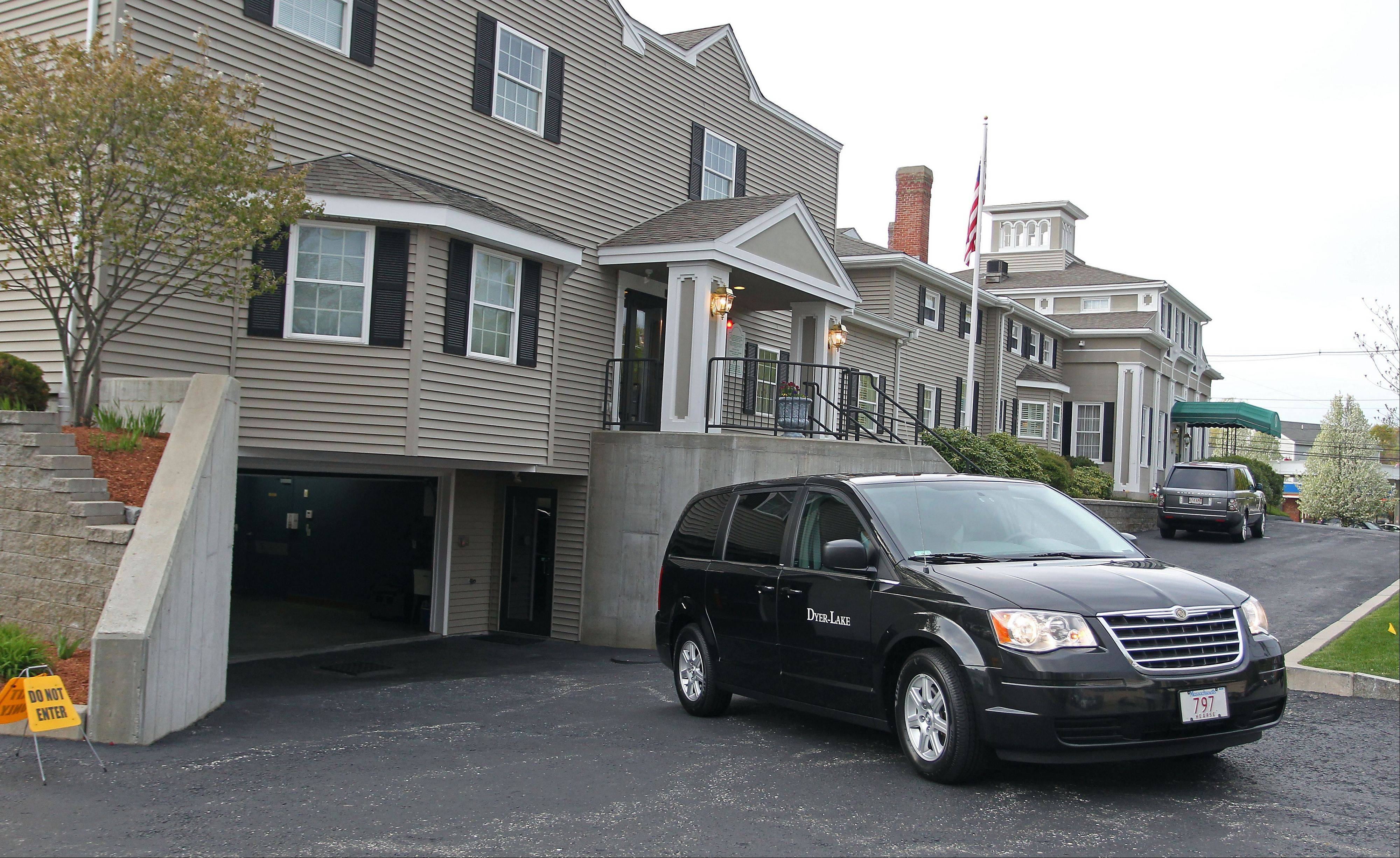 A vehicle believed to be carrying the body of Boston Marathon bombing suspect Tamerlan Tsarnaev backs into an underground garage at a funeral home Thursday in North Attleborough, Mass. The body of Tsarnaev, who was the subject of a massive manhunt and died after a gunbattle with police, was claimed Thursday.