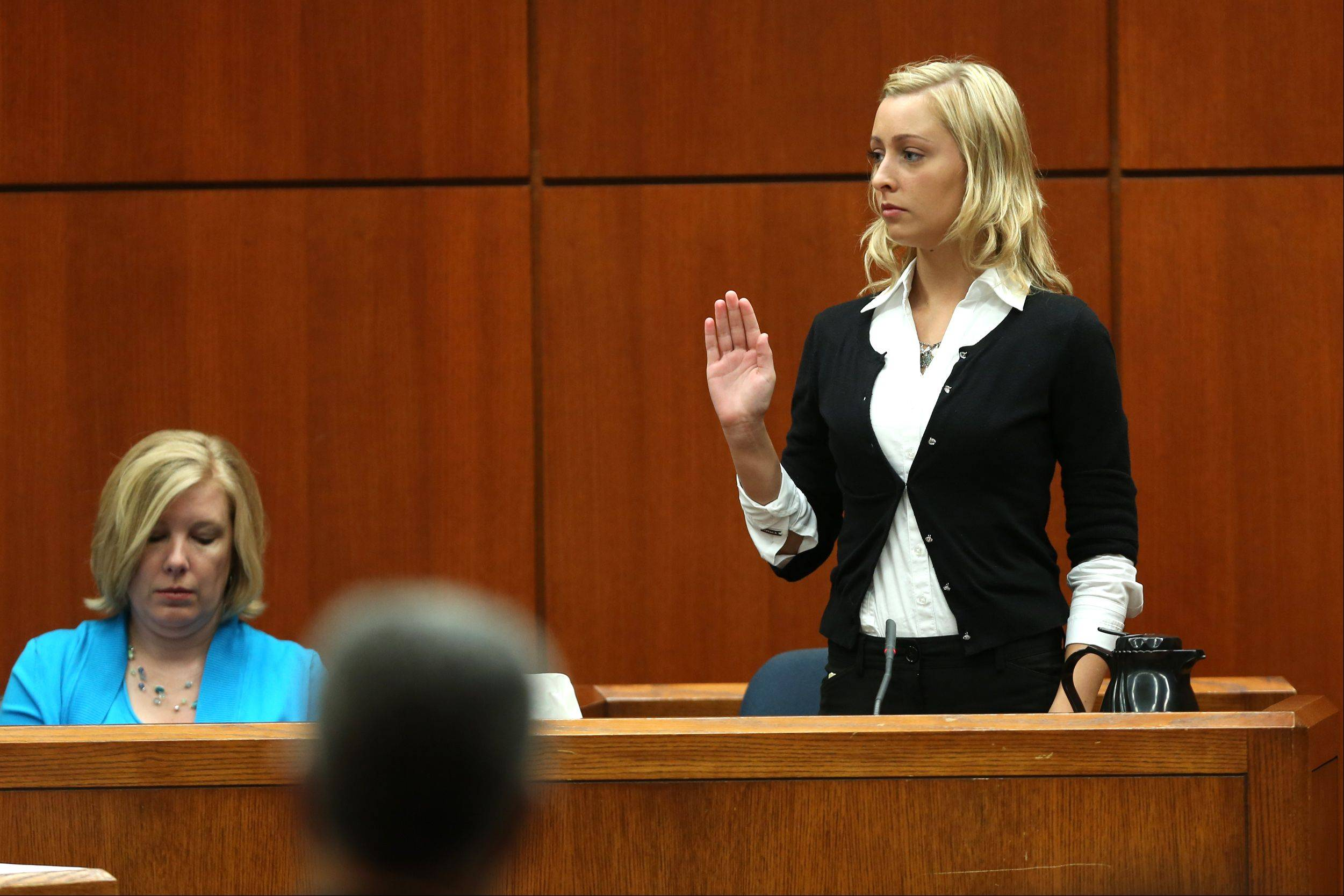 Linnea Nodarse, right, sister of convicted gunman Jacob Nodarse, is sworn in Thursday at the Johnny Borizov trial in Wheaton.