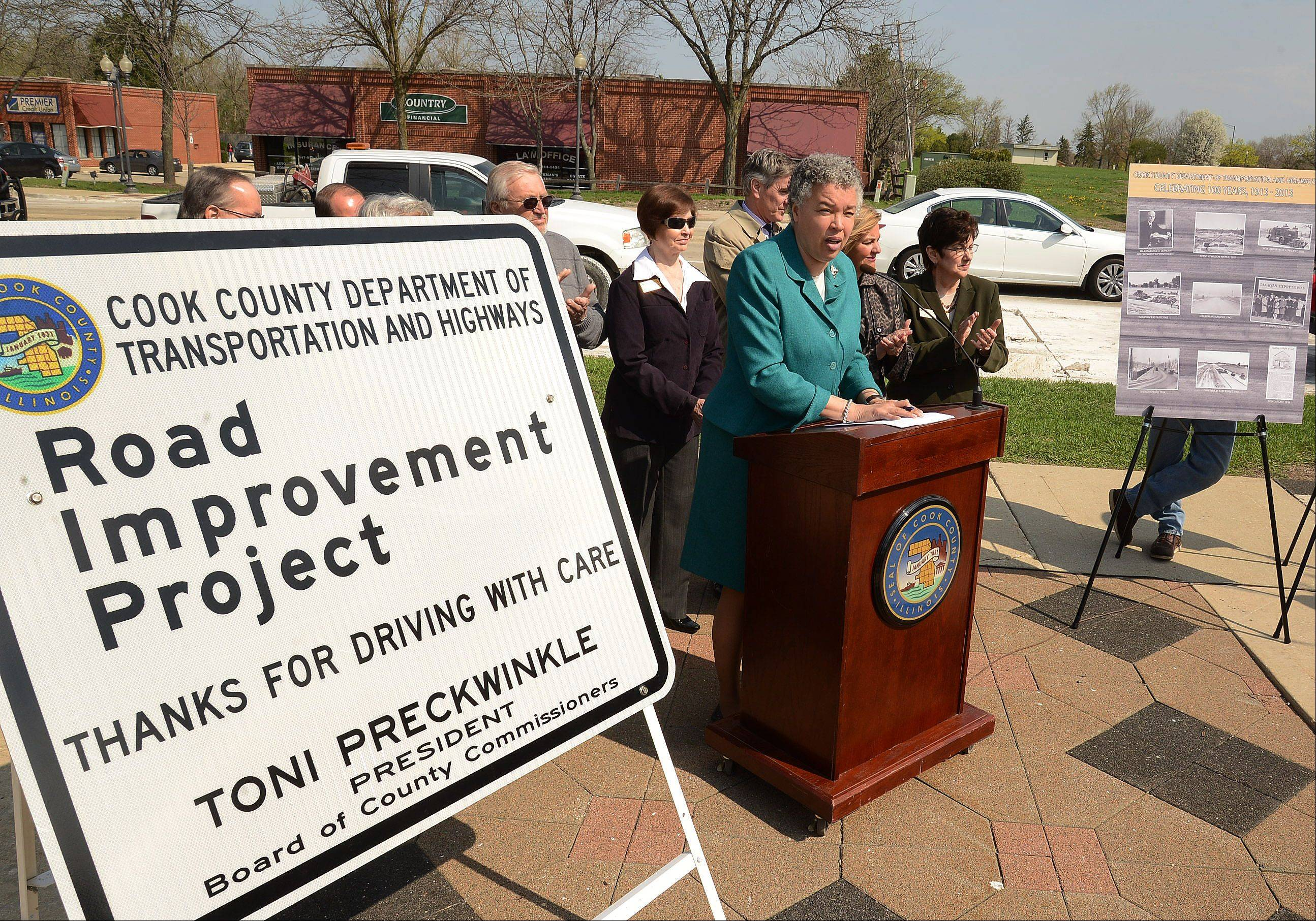 Cook County Board President Toni Preckwinkle joins Schaumburg officials to discuss joint road projects at the corner of Roselle and Schaumburg Roads in Schaumburg. The intersection will get new turn lanes this year as part of a cooperative effort between the village and county.