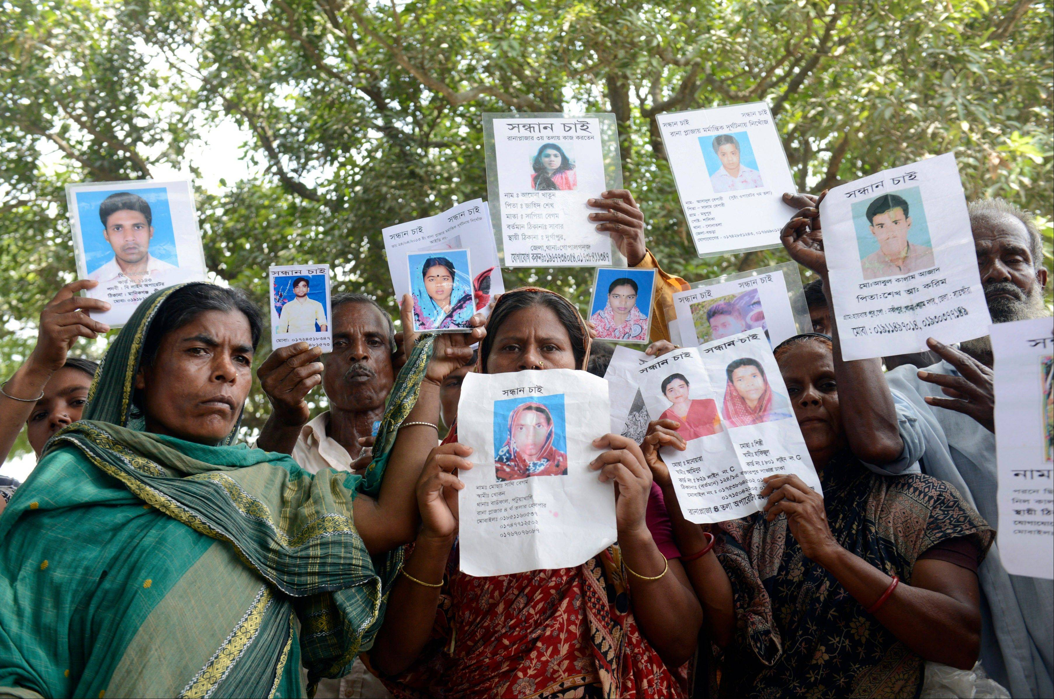 Relatives hold up portraits of many still missing from last week's collapse of a garment factory building in Bangladesh. Rescuers found more bodies in the concrete debris of the collapsed garment factory building Thursday, bringing the toll to 430 confirmed dead. Another 149 people are still missing in what has become the worst disaster for Bangladesh's $20 billion-a-year garment industry that supplies global retailers.