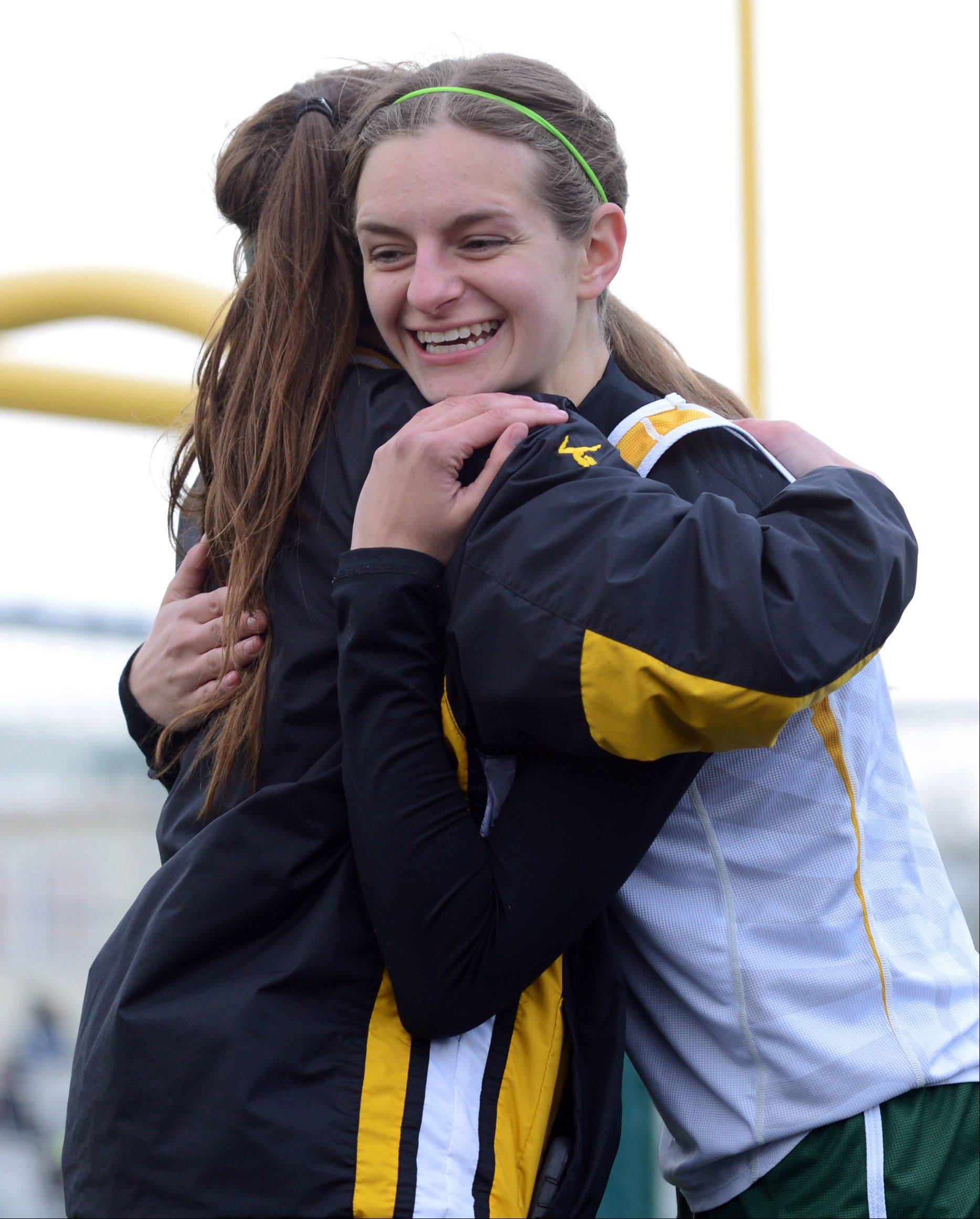 Stevenson high jumper Jackie Setina gets a hug after making one of her jumps during the North Suburban Conference girls track meet Thursday at Stevenson High School in Lincolnshire.