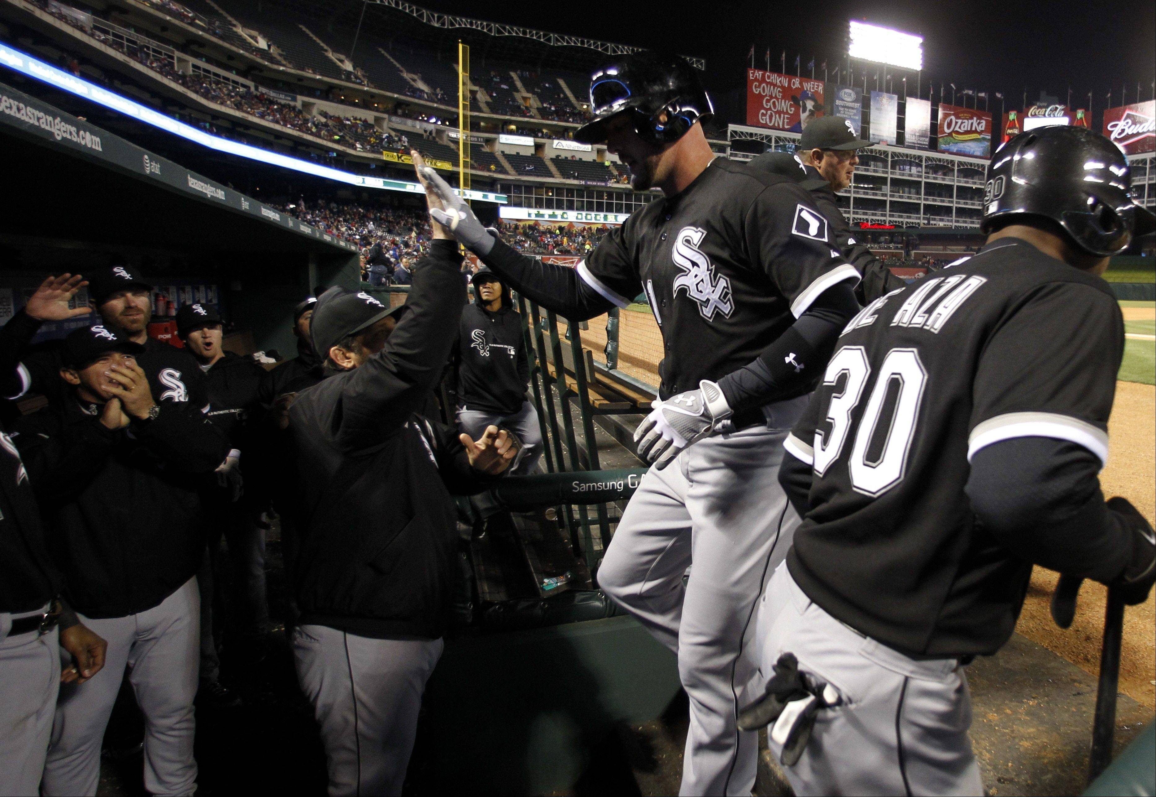 The White Sox�s Tyler Flowers, second from right, is congratulated as he reaches the dugout following his three-run home run off Texas Rangers� Justin Grimm in the sixth inning of a baseball game on Thursday in Arlington. The hit also scored Conor Gillaspie and Alexei Ramirez.