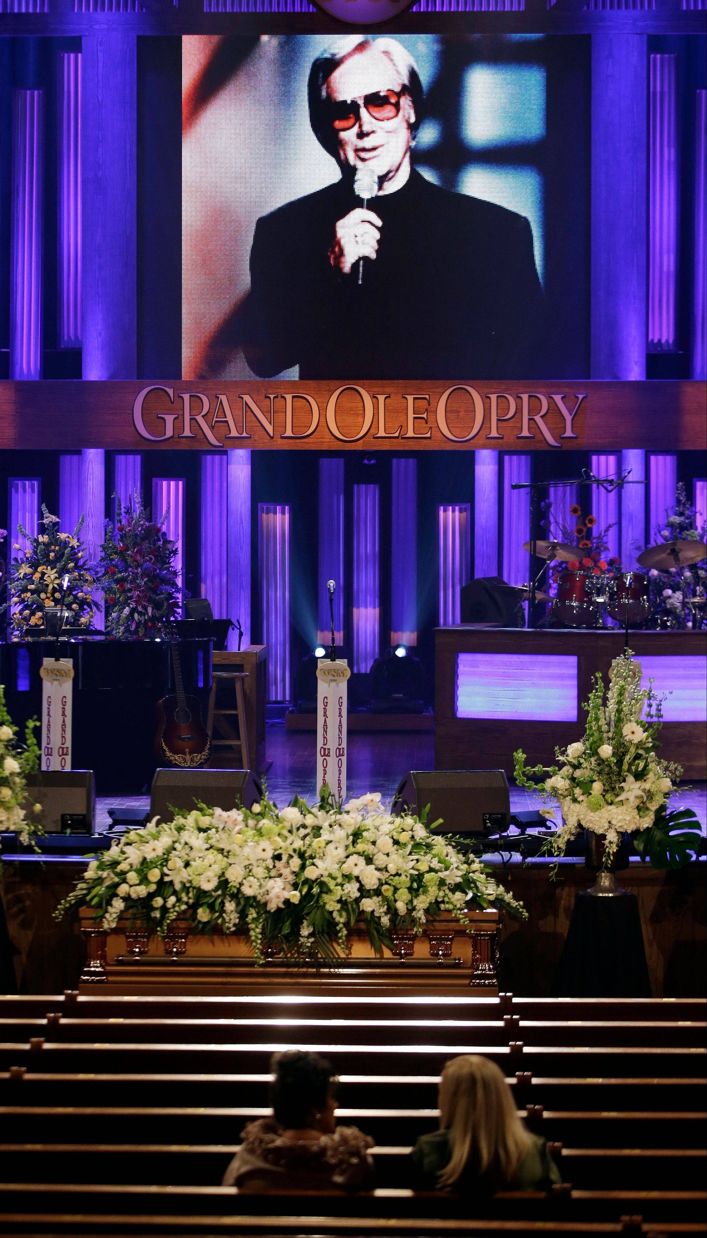 The casket for country music legend George Jones lies in the Grand Ole Opry House before his funeral Thursday in Nashville, Tenn.