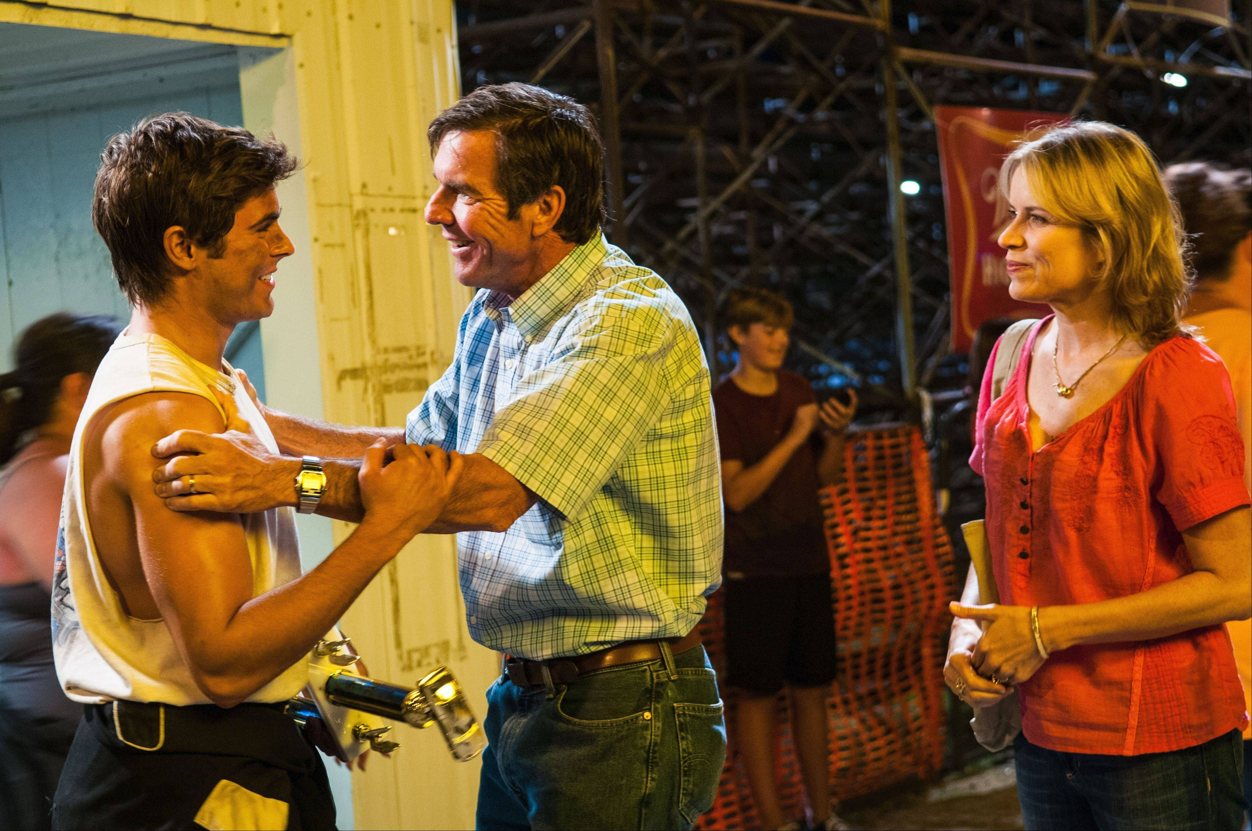 "Dean (Zac Efron), left, is greeted by his dad, Henry (Dennis Quaid), while his mom (Kim Dickens) awaits in the dense farm drama ""At Any Price."""