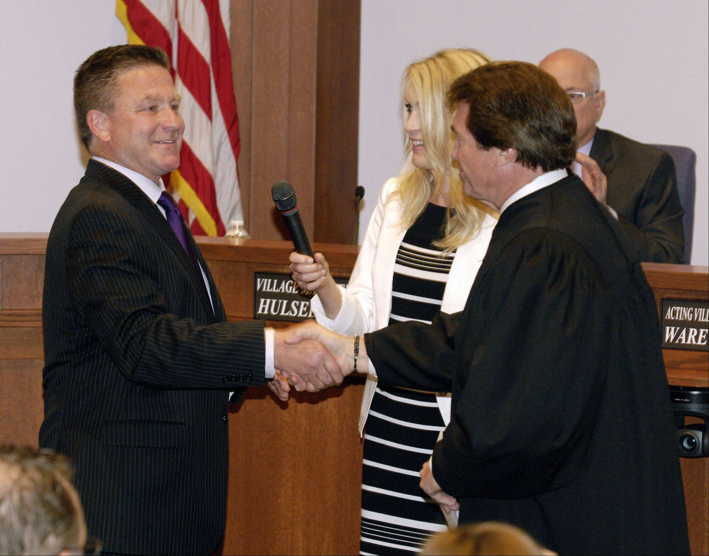 Lombard Village President Keith Giagnorio shakes hands with DuPage County Judge Patrick O'Shea after Giagnorio was sworn into his new role Thursday night.