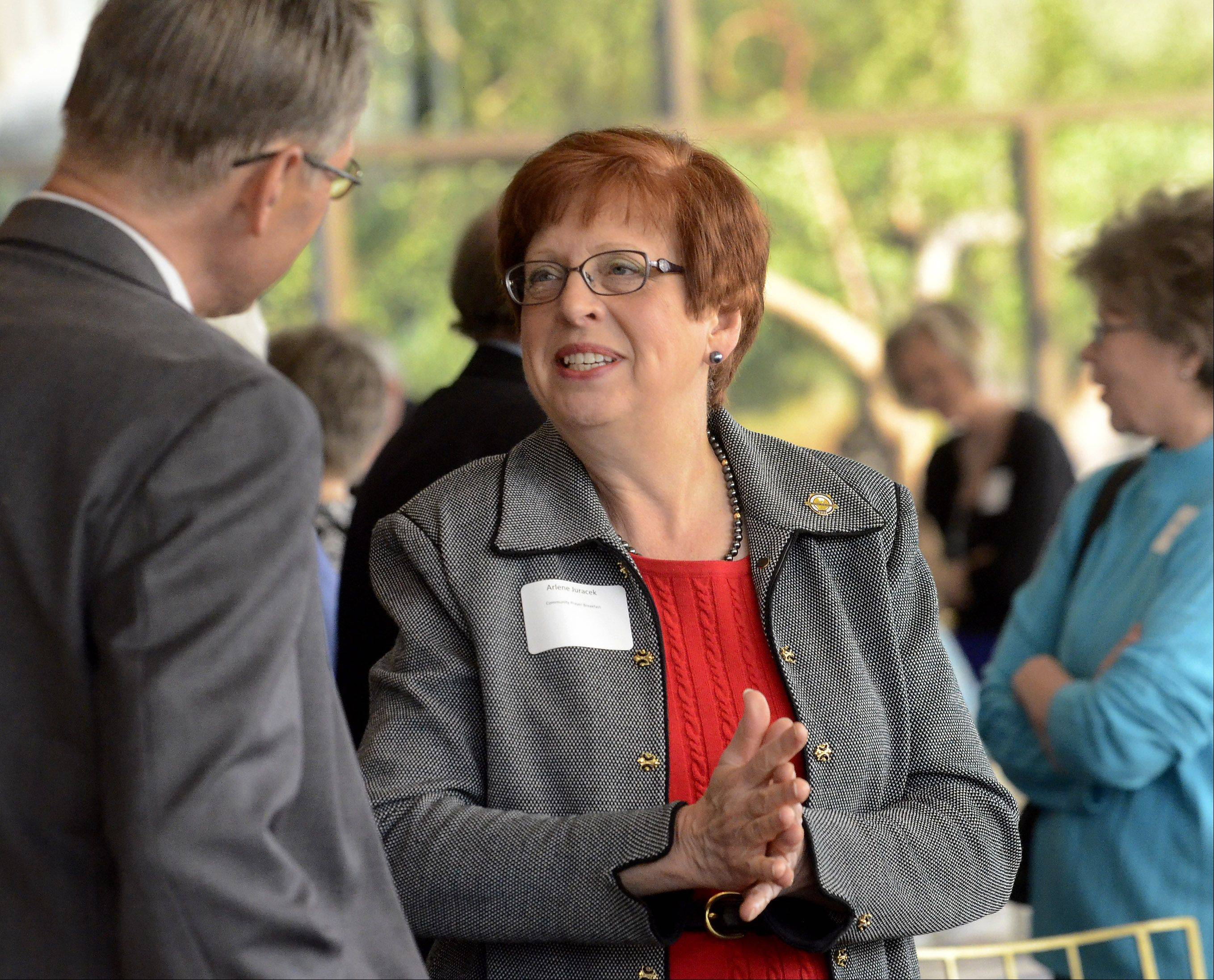 Incoming Mount Prospect Mayor Arlene Juracek chats with guests before the village's annual Community Prayer Breakfast.