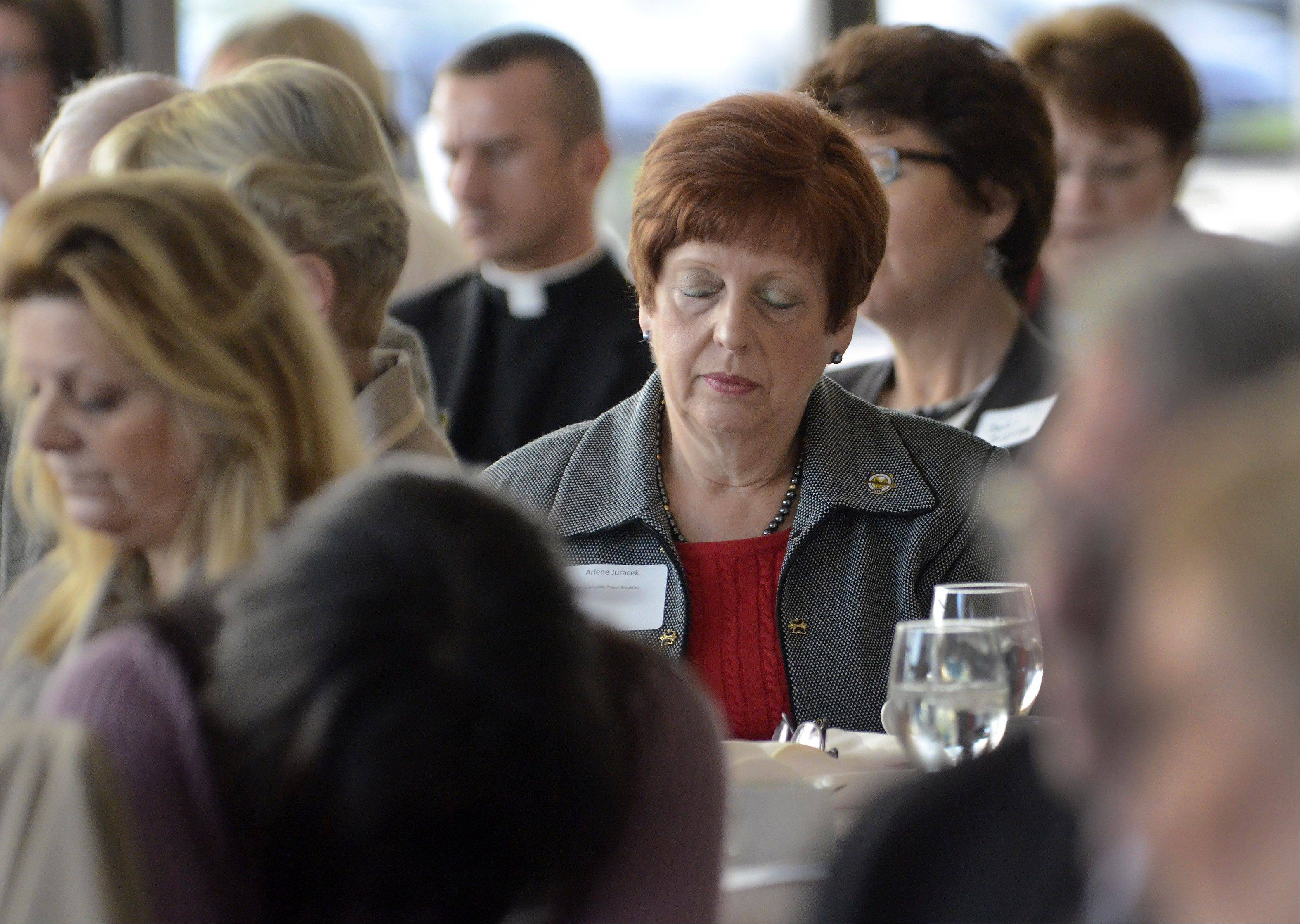 Incoming Mount Prospect Mayor Arlene Juracek prays Thursday at the village's annual Community Prayer Breakfast.