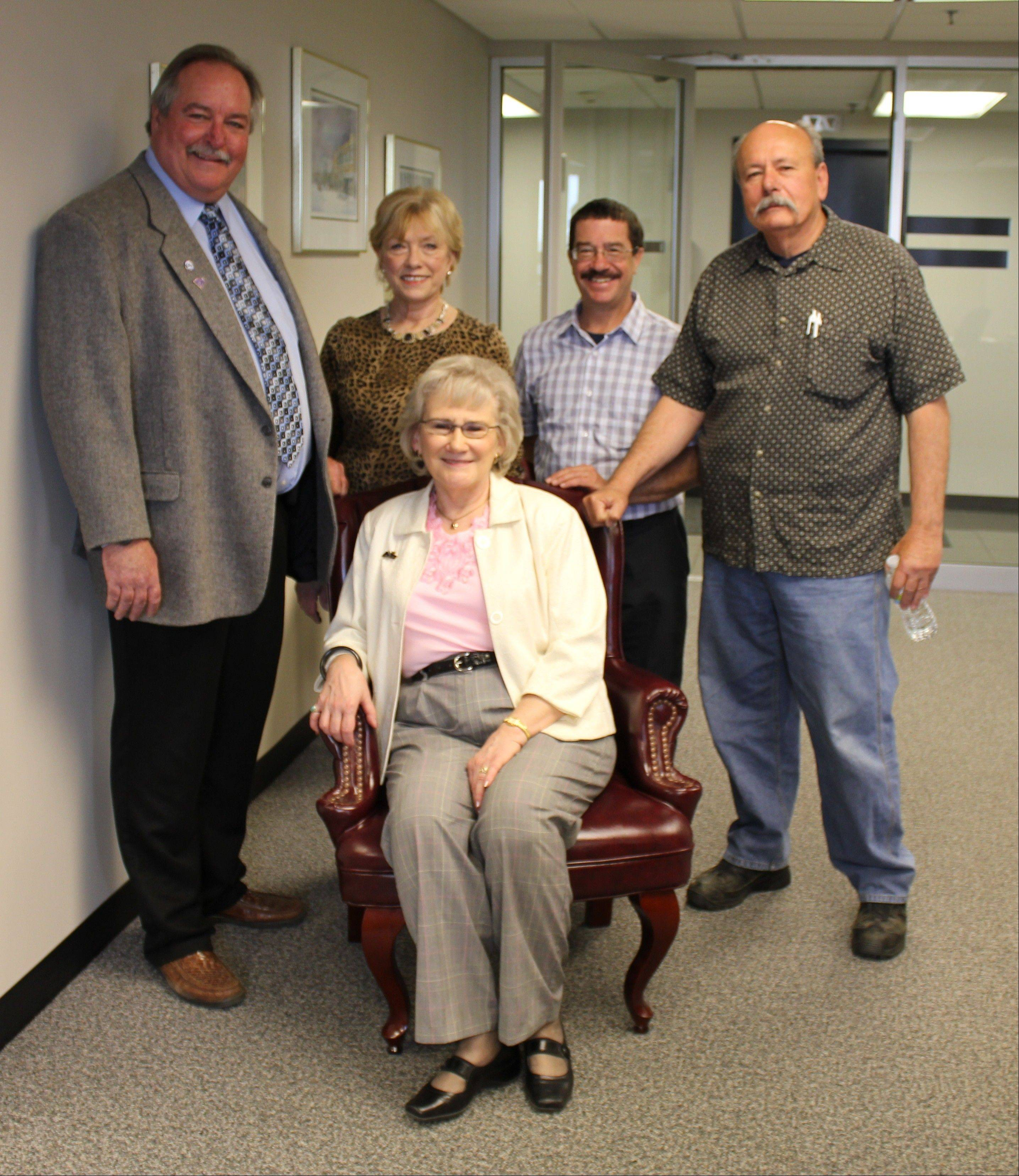 Longtime Des Plaines mayor's secretary Donna Catlett retired this week after serving 16 years under three elected mayors, and four acting mayors. From left, acting Mayor Mark Walsten, and aldermen, Patti Haugeberg (1st Ward), Mike Charewicz (8th), and John Robinson (2nd), bid farewell to Catlett, seated, Thursday.