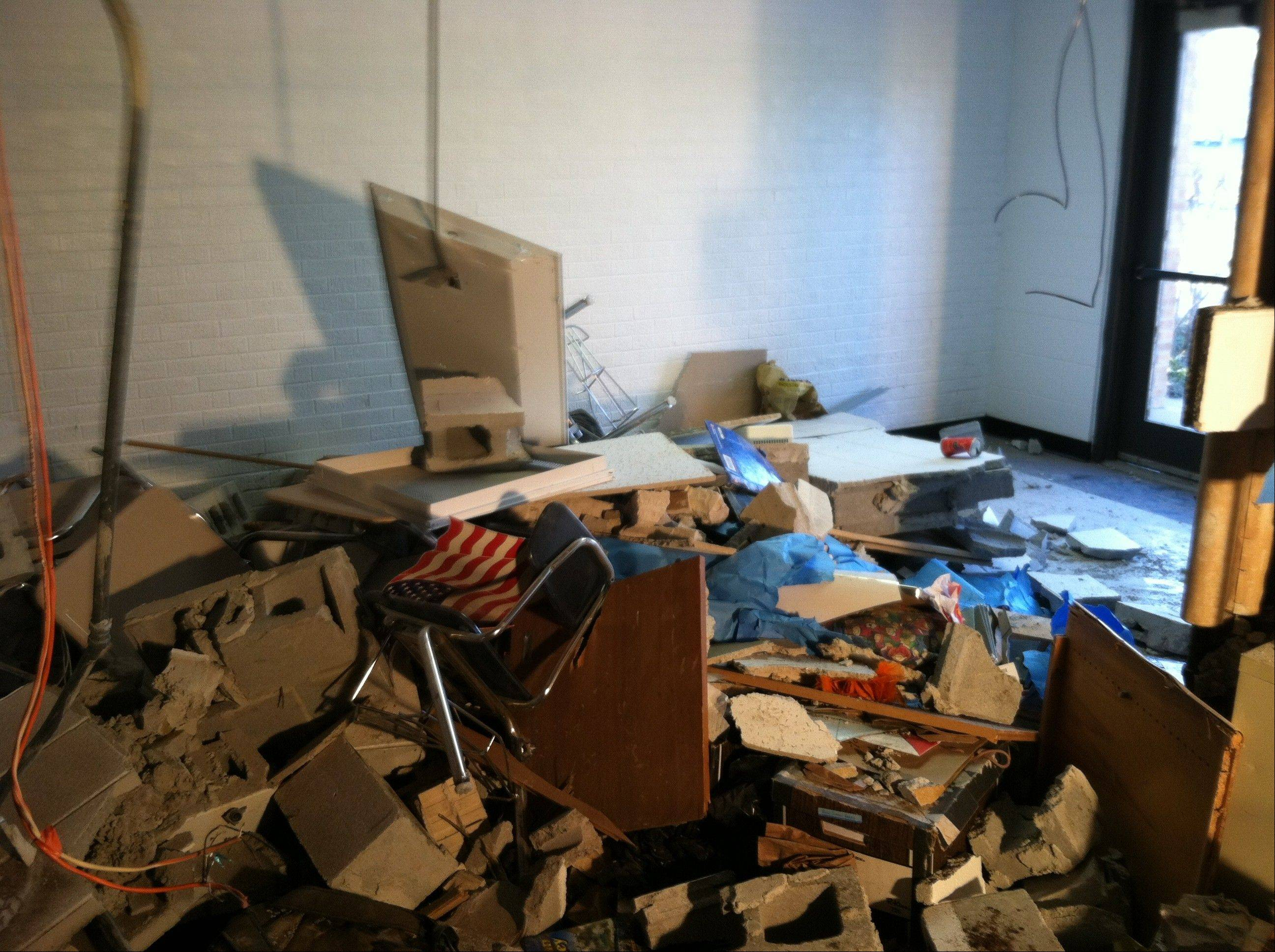 Destruction inside the Grove Junior High classroom that was hit by the car.
