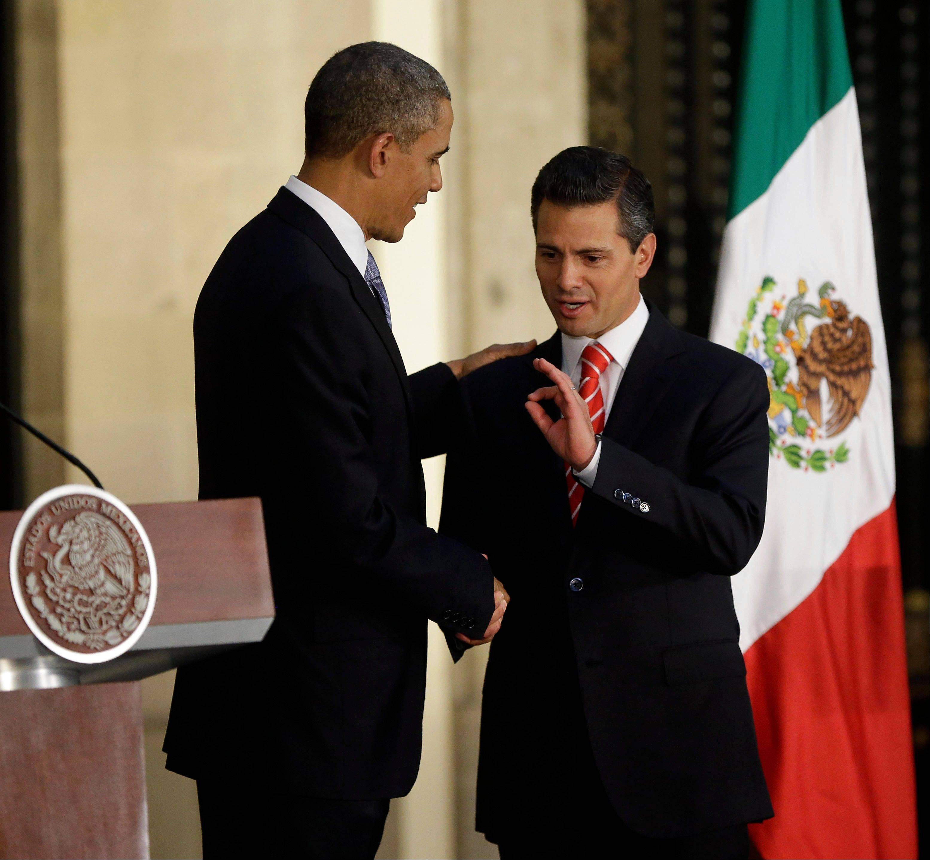 President Barack Obama said his administration will continue its close cooperation with Mexico to battle drug trafficking and organized crime even as Mexican President Enrique Pena Nieto, right, moves to restrict access by U.S. security agencies.