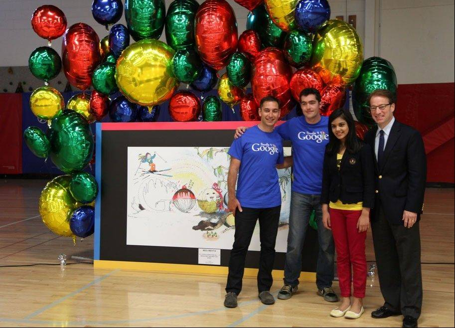 Google marketing managers Sam Saliba, left, and Ben Wallace, join Congressman Peter Roskam of Wheaton, right, in announcing Meg Mehta of South Barrington as Illinois' entry in the Doodle 4 Google contest.