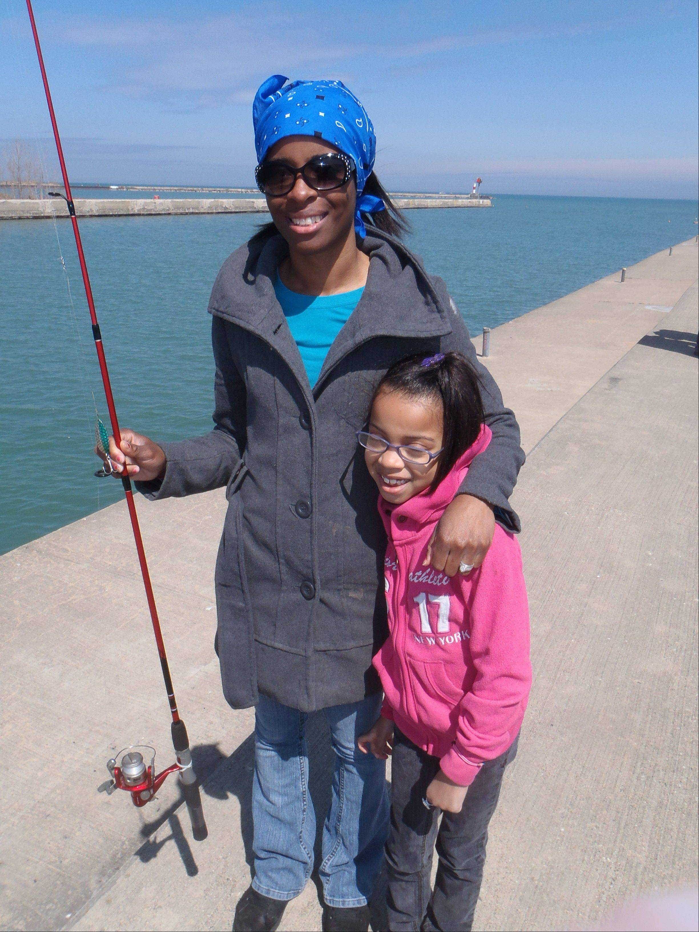 Nadine Thompson and her daughter Savannah warmed to the opportunity to try for brown trout along Government Pier in Waukegan.