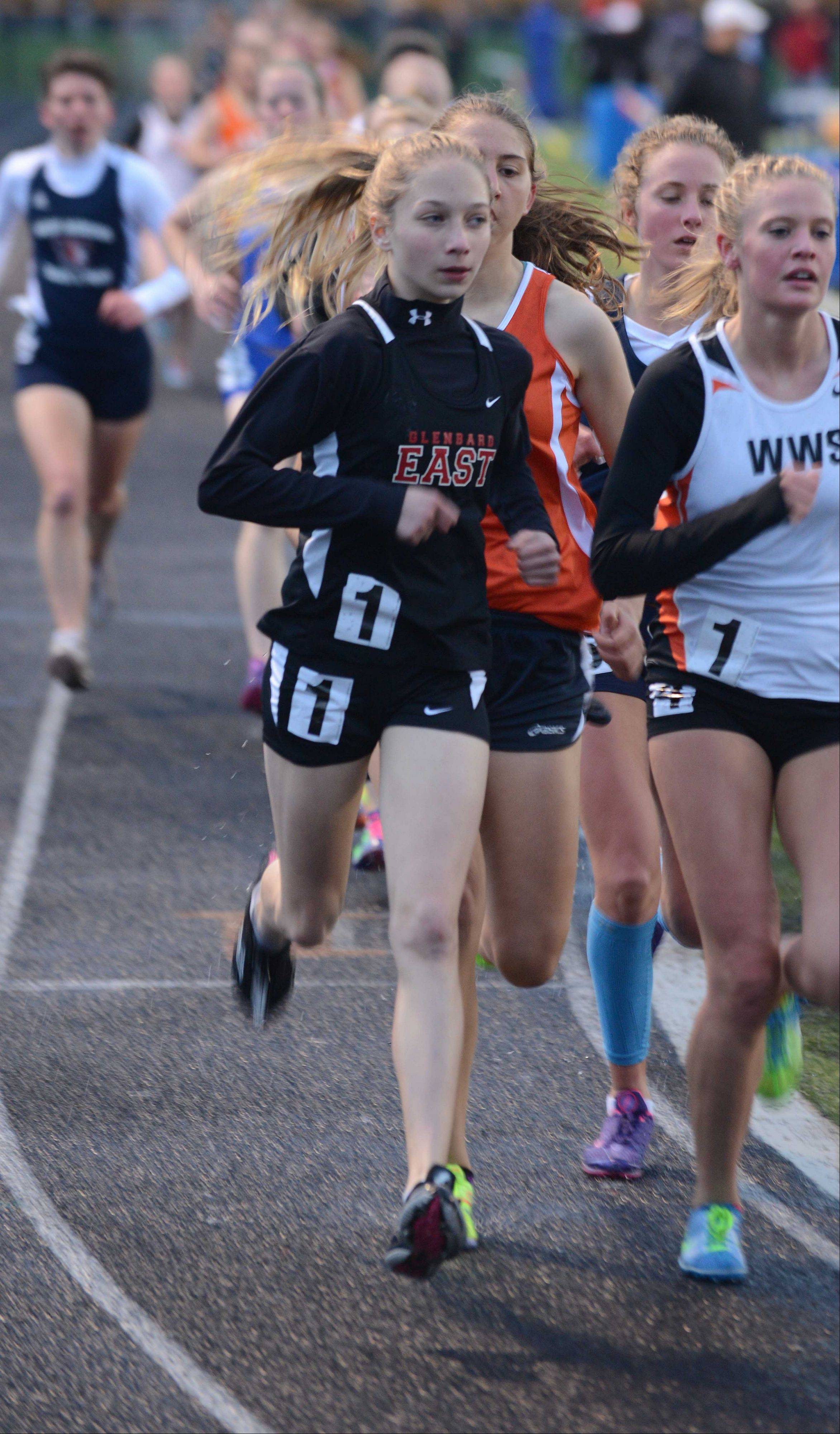 Lindsay Graham of Glenbard East runs the 3200 during the DuPage Valley Conference girls track finals Thursday at Naperville North.
