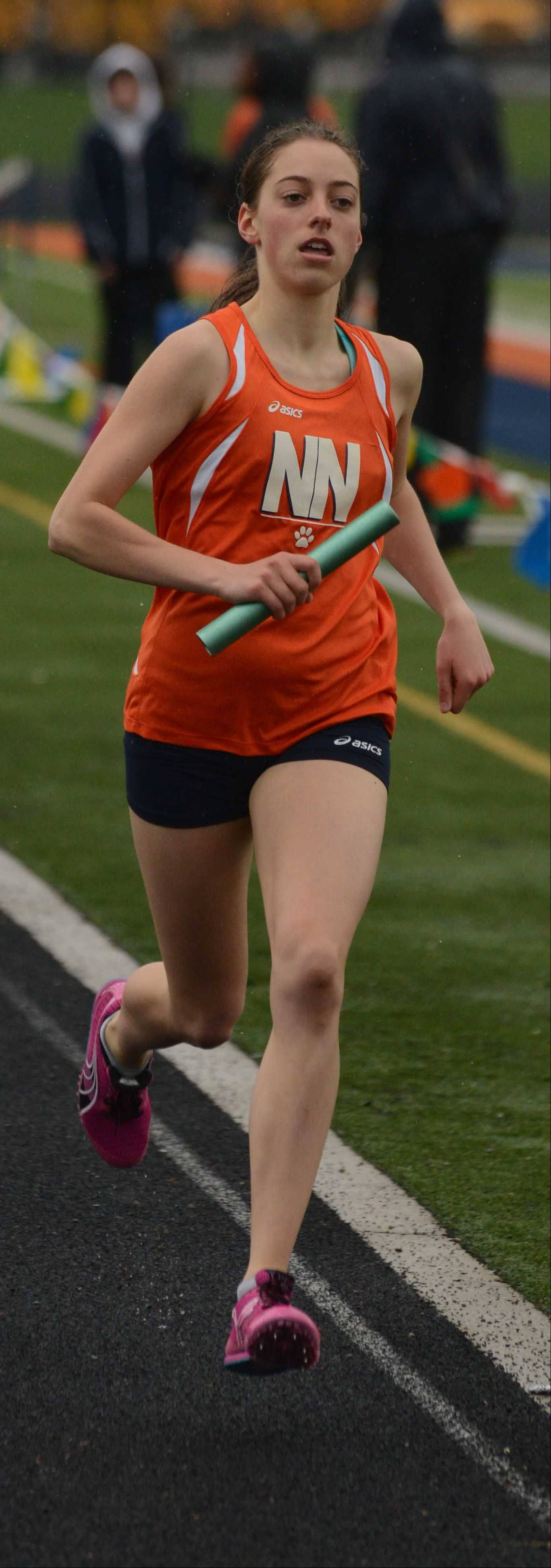 Allison Trezona of Naperville North took part in the 4x800 during the DuPage Valley Conference girls track finals Thursday at Naperville North.