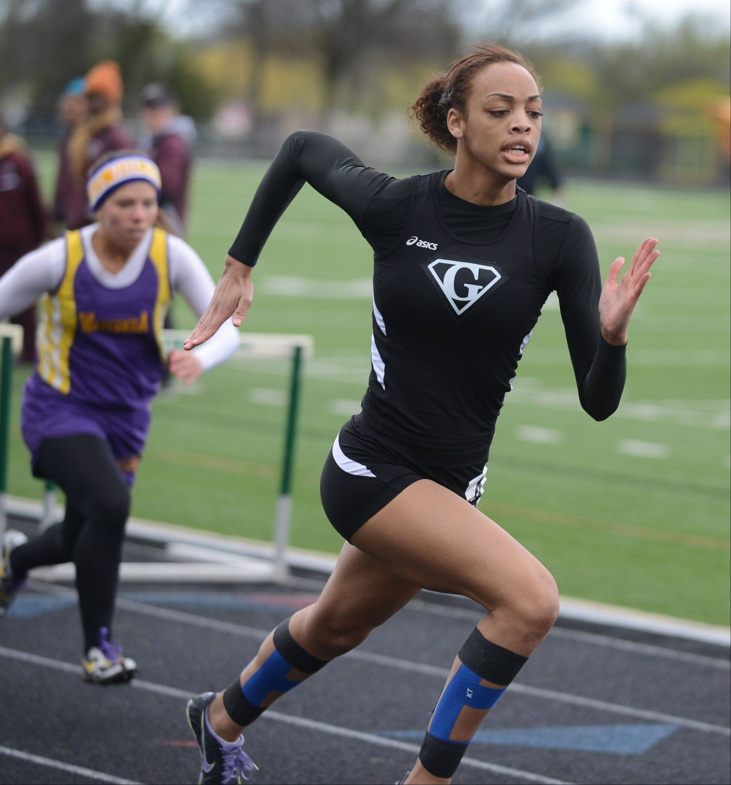 Grant's Julia Sangster charges to the finish line in a 100-meter hurdles preliminary race Thursday at the North Suburban Conference girls track meet in Lincolnshire.