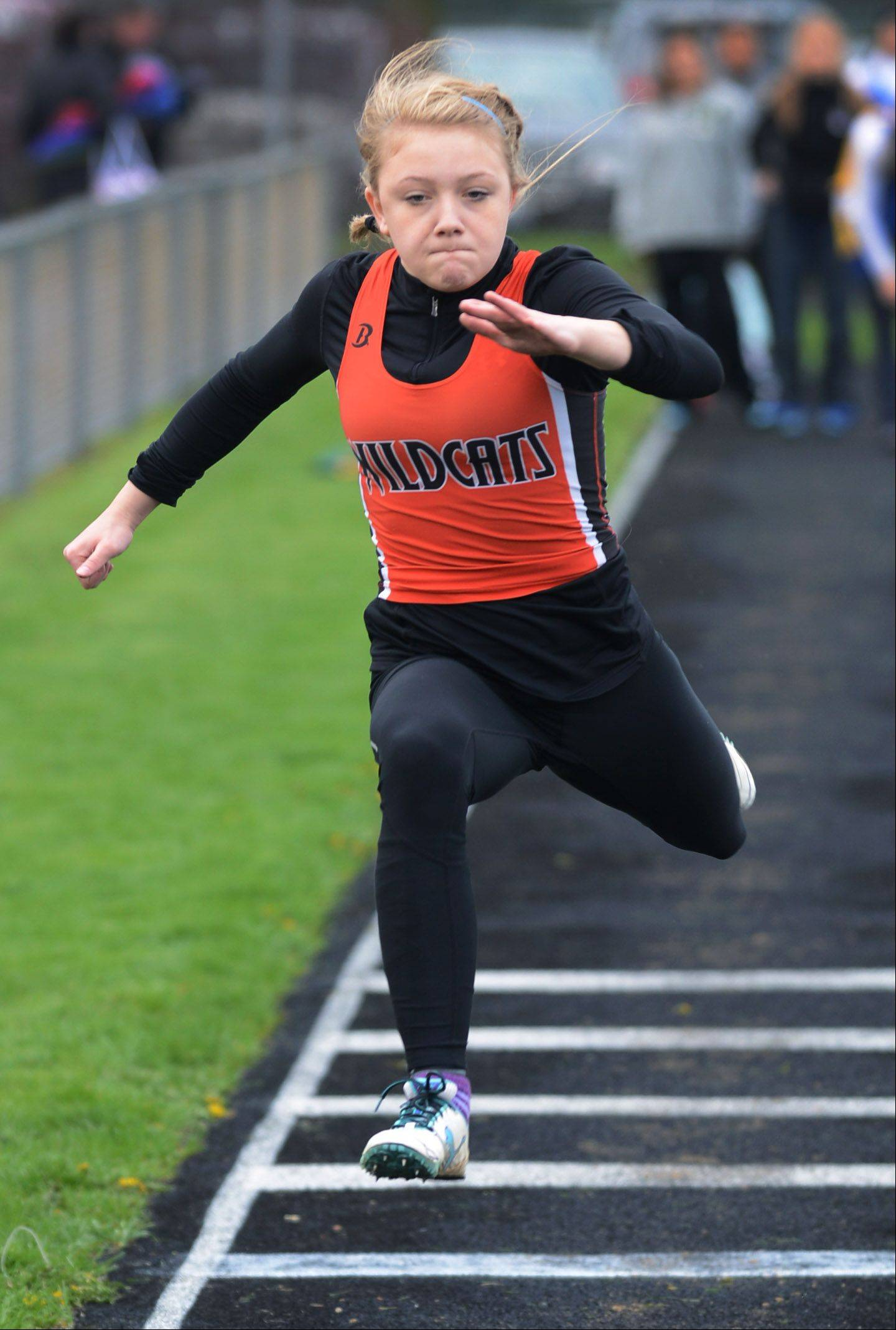 Libertyville's Rachel Metcalf takes off during the triple jump competition during the North Suburban Conference girls track meet Thursday at Stevenson High School in Lincolnshire.
