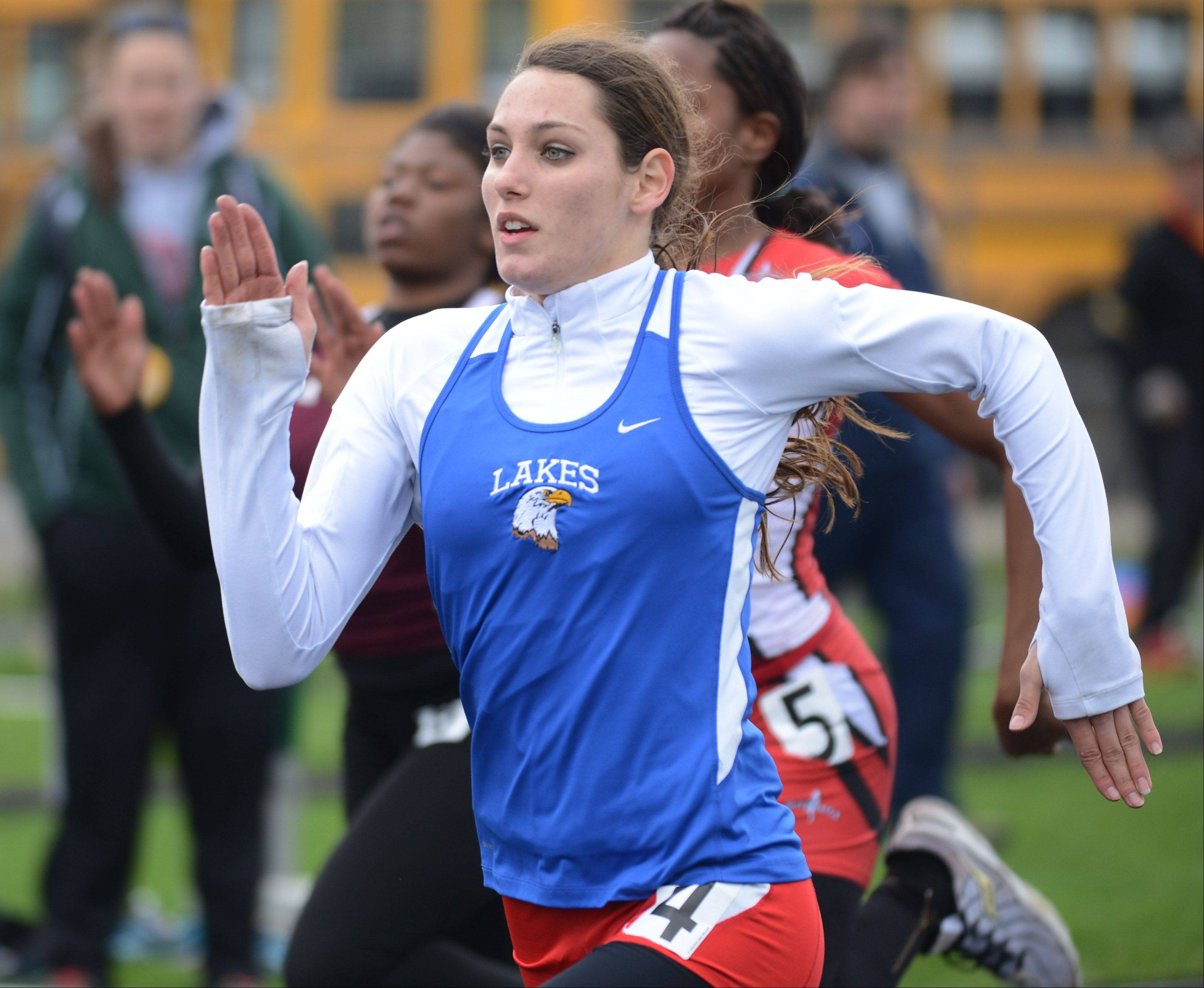 Lakes' Brittani Griesbaum takes off on her 100-meter dash preliminary race Thursday at the North Suburban Conference girls track meet at Stevenson High School in Lincolnshire.