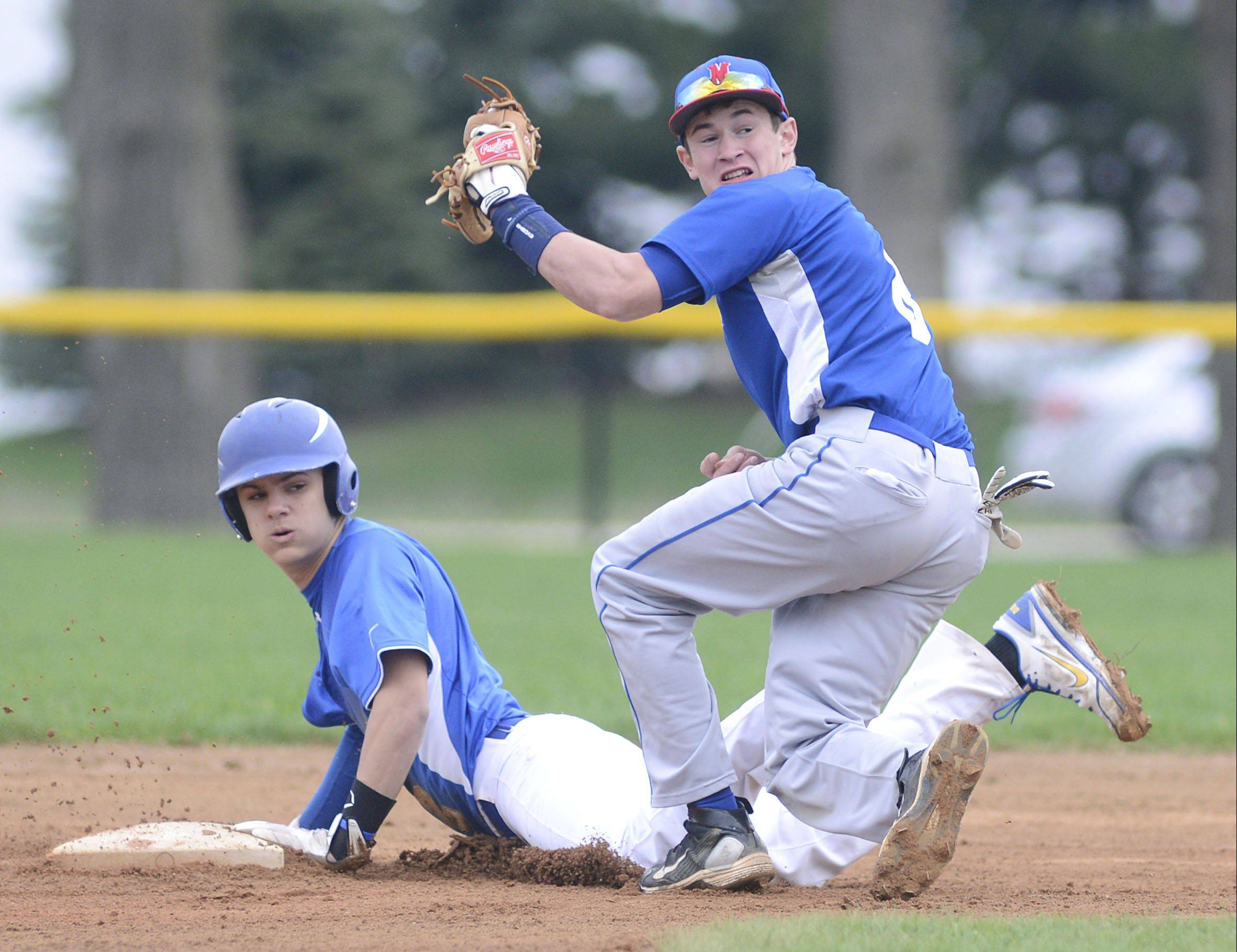 Aurora Central's Jake McCarthy is safe on second base from Marmion's Josh Meyers in the first inning on Thursday, May 2.