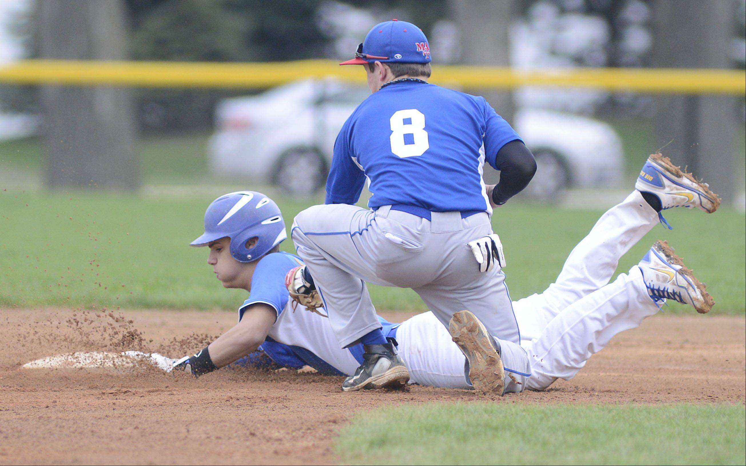 Marmion's Josh Meyers attempts to tag out Aurora Central's Jake McCarthy at second base to no avail in the first inning on Thursday, May 2.