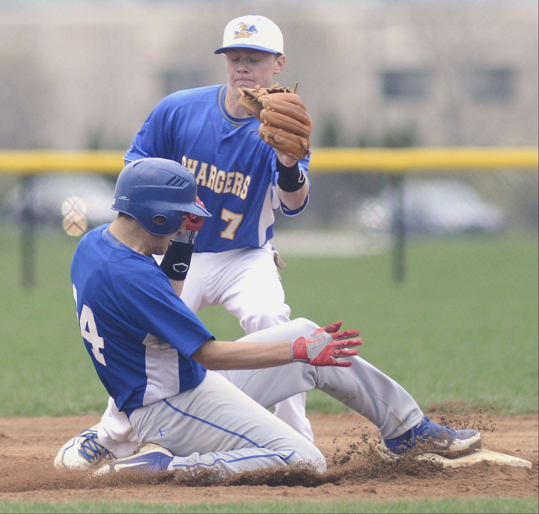 Marmion's Corey Friel is safe back on second base from Aurora Central's Andre Bruss in the third inning on Thursday, May 2.