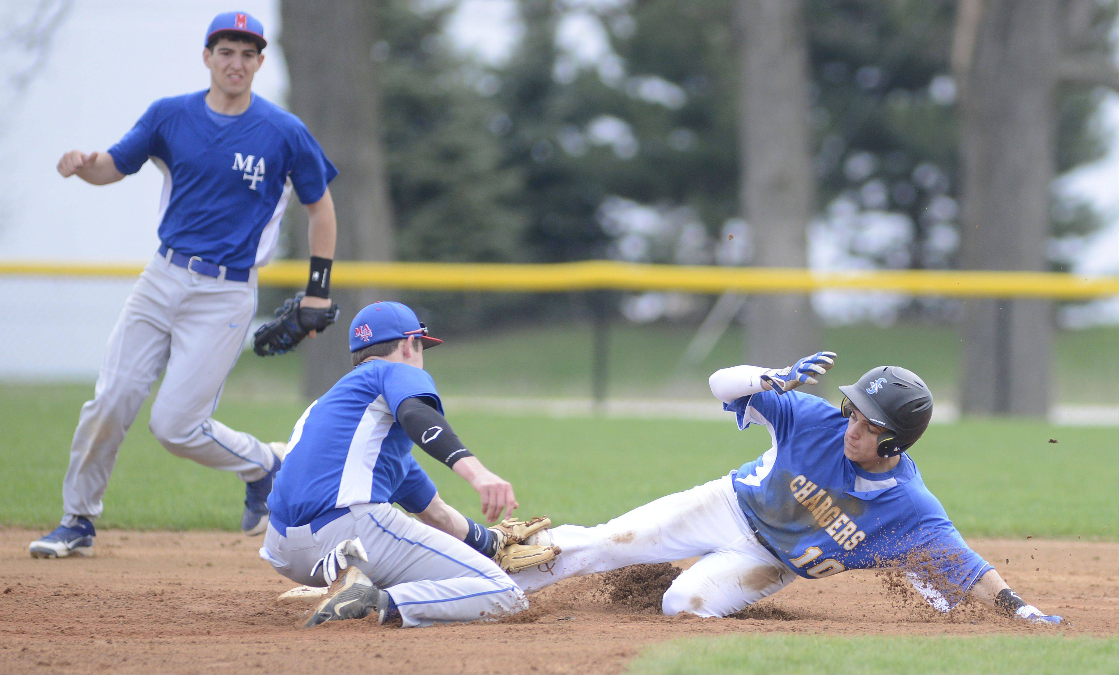 Aurora Central's Hunter Fiorito is safe on a slide into second base from Marmion's Josh Meyers in the first inning on Thursday, May 2.