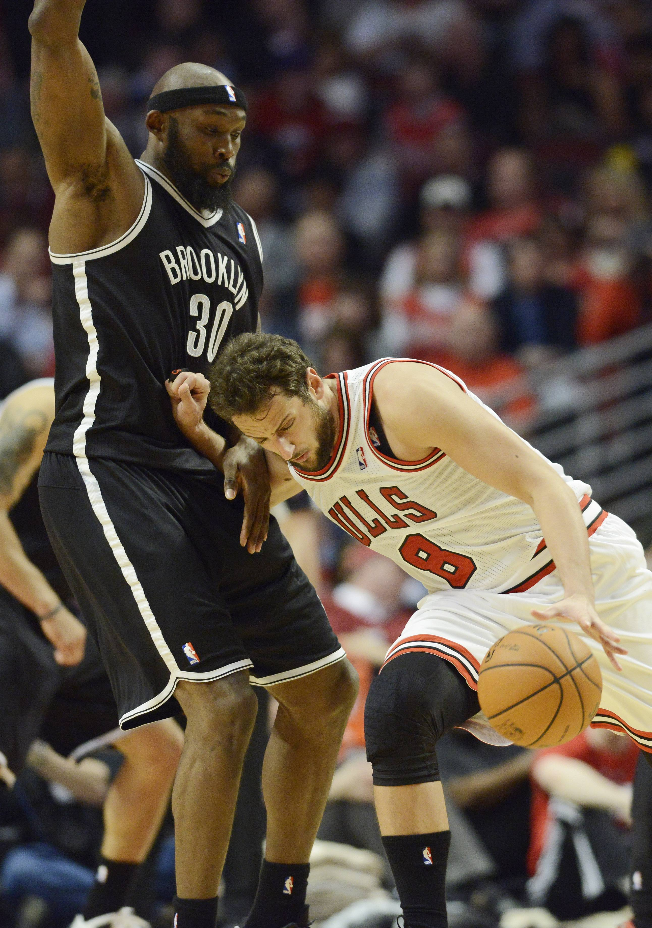 Marco Belinelli of the Chicago Bulls gets called for an offensive foul against Reggie Evans of the Brooklyn Nets in Game 6 of the first round playoff game at the United Center in Chicago, Thursday, May 2, 2013.