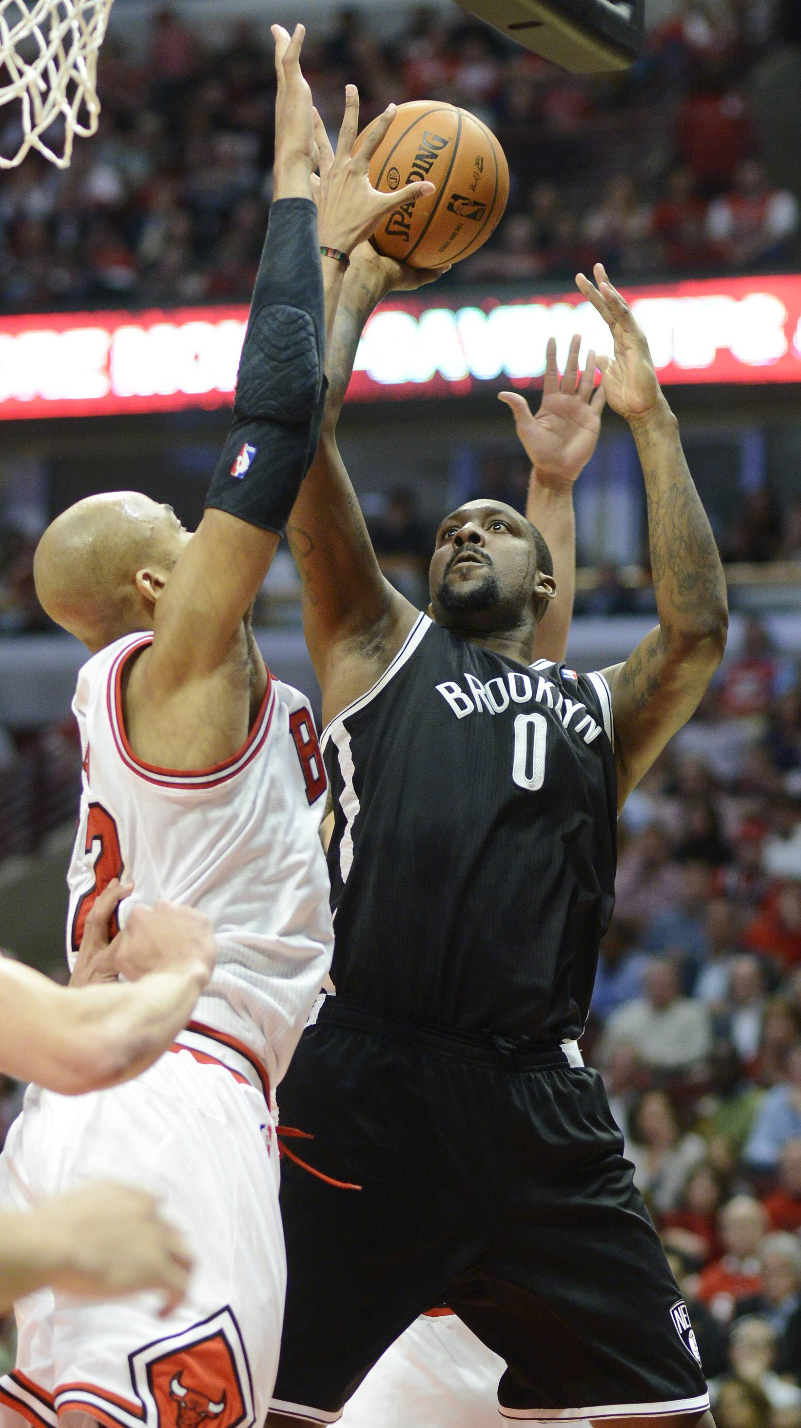 Andray Blatche of the Brooklyn Nets goes to the basket against Taj Gibson Chicago Bulls in Game 6 of the first round playoff game at the United Center in Chicago, Thursday, May 2, 2013.