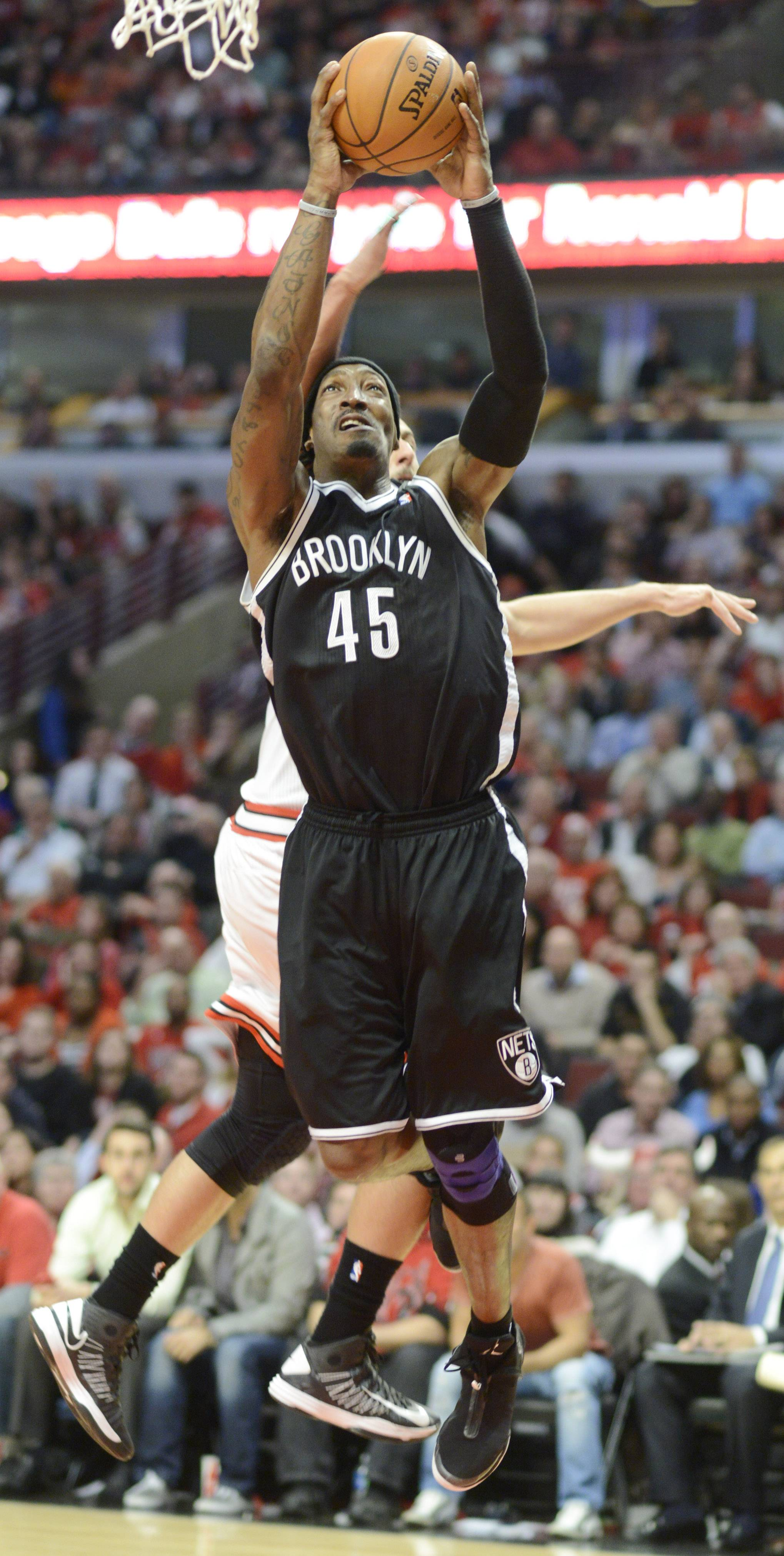 Gerald Wallace of the Brooklyn Nets goes to the basket against marco Belinelli of the Chicago Bulls in Game 6 of the first round playoff game at the United Center in Chicago, Thursday, May 2, 2013.