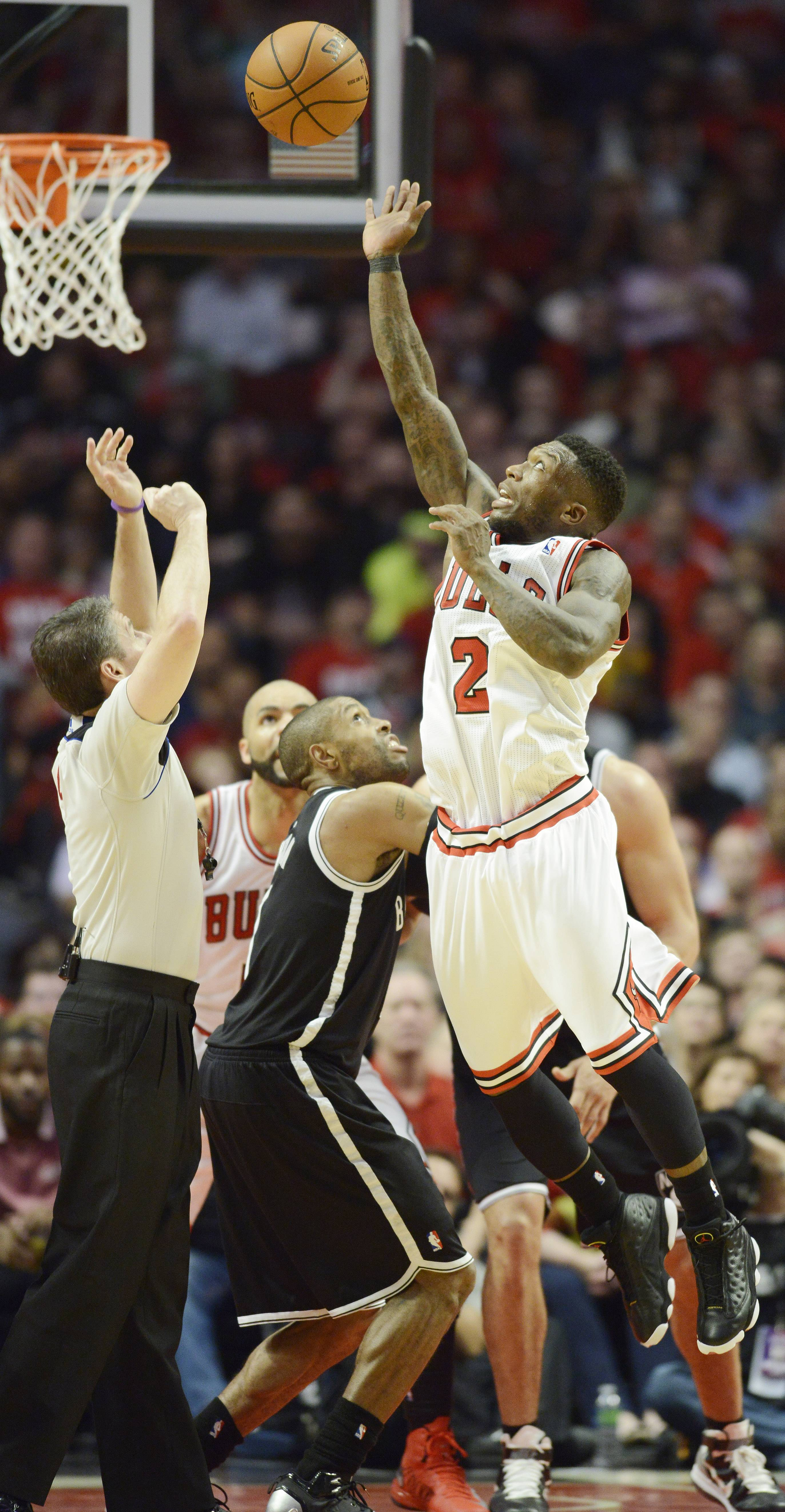 Nate Robinson of the Chicago Bulls leaps high on a second effort for a jump ball  in Game 6 of the first round playoff game at the United Center in Chicago, Thursday, May 2, 2013.