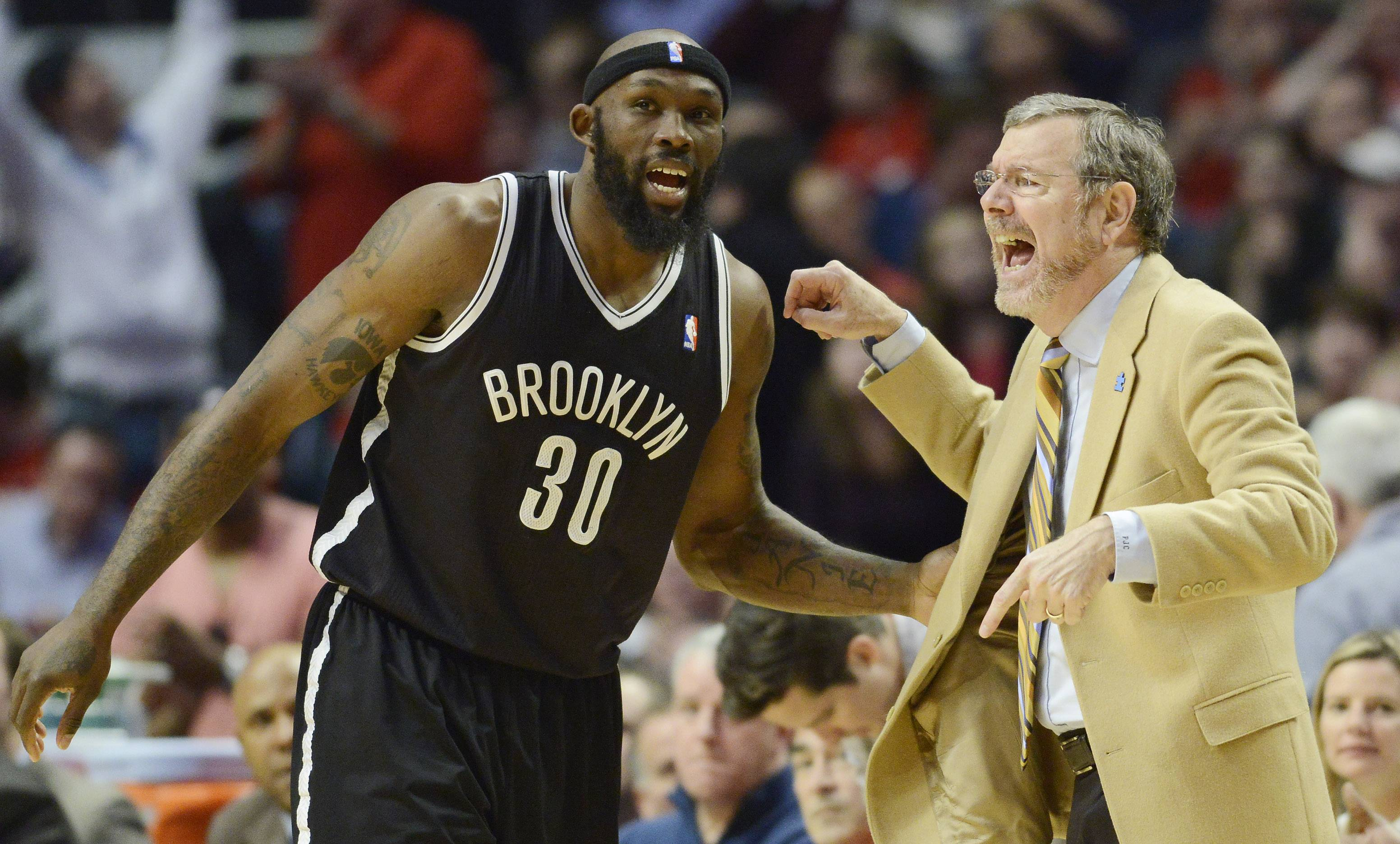 Brooklyn Nets coach P.J. Carlesimo talks with Reggie Evans in Game 6 of the first round playoff game against the Chicago Bulls at the United Center in Chicago, Thursday, May 2, 2013.