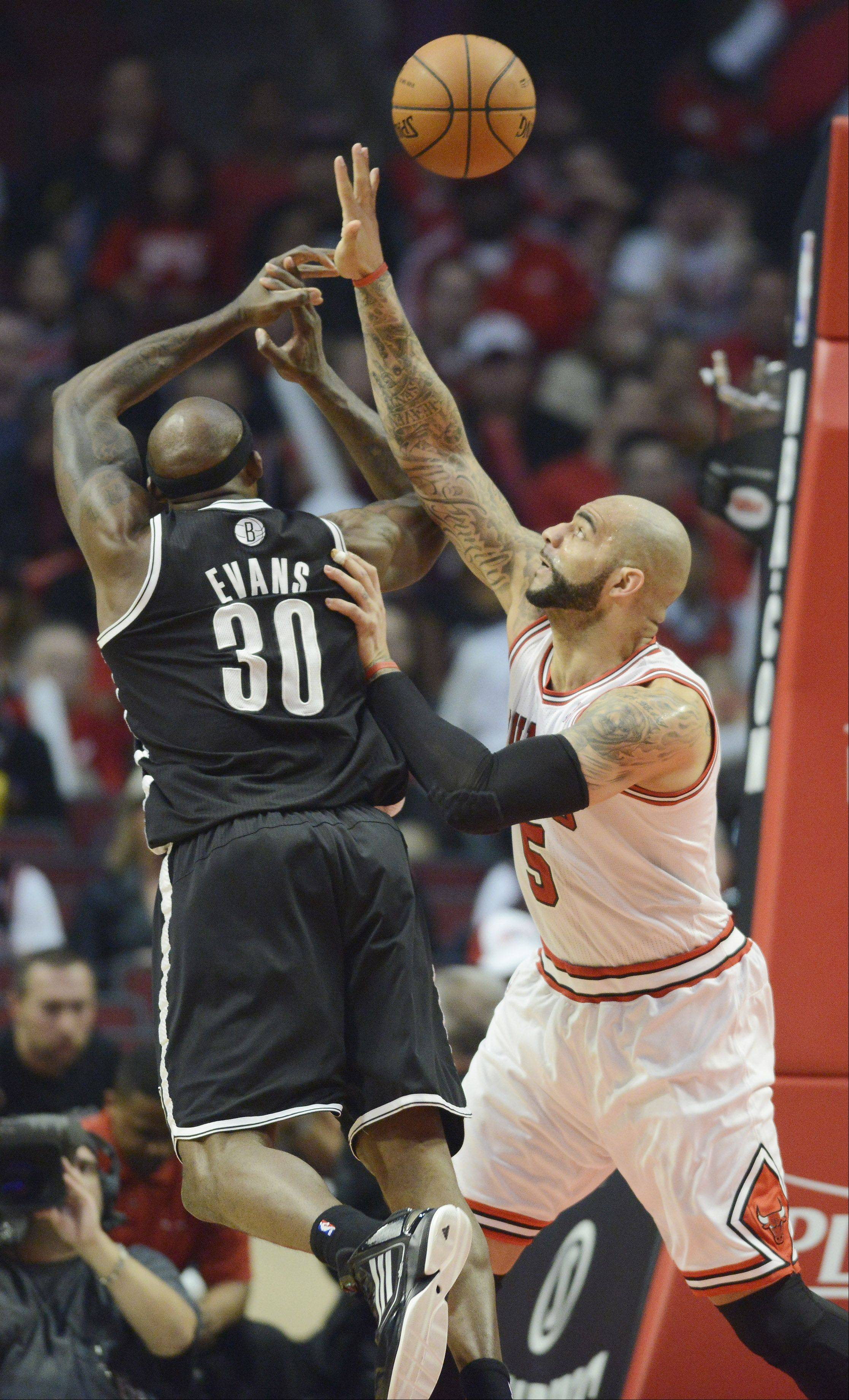 Reggie Evans of the Brooklyn Nets gets fouled by Carlos Boozer of the Chicago Bulls in Game 6 of the first round playoff game at the United Center in Chicago, Thursday, May 2, 2013.