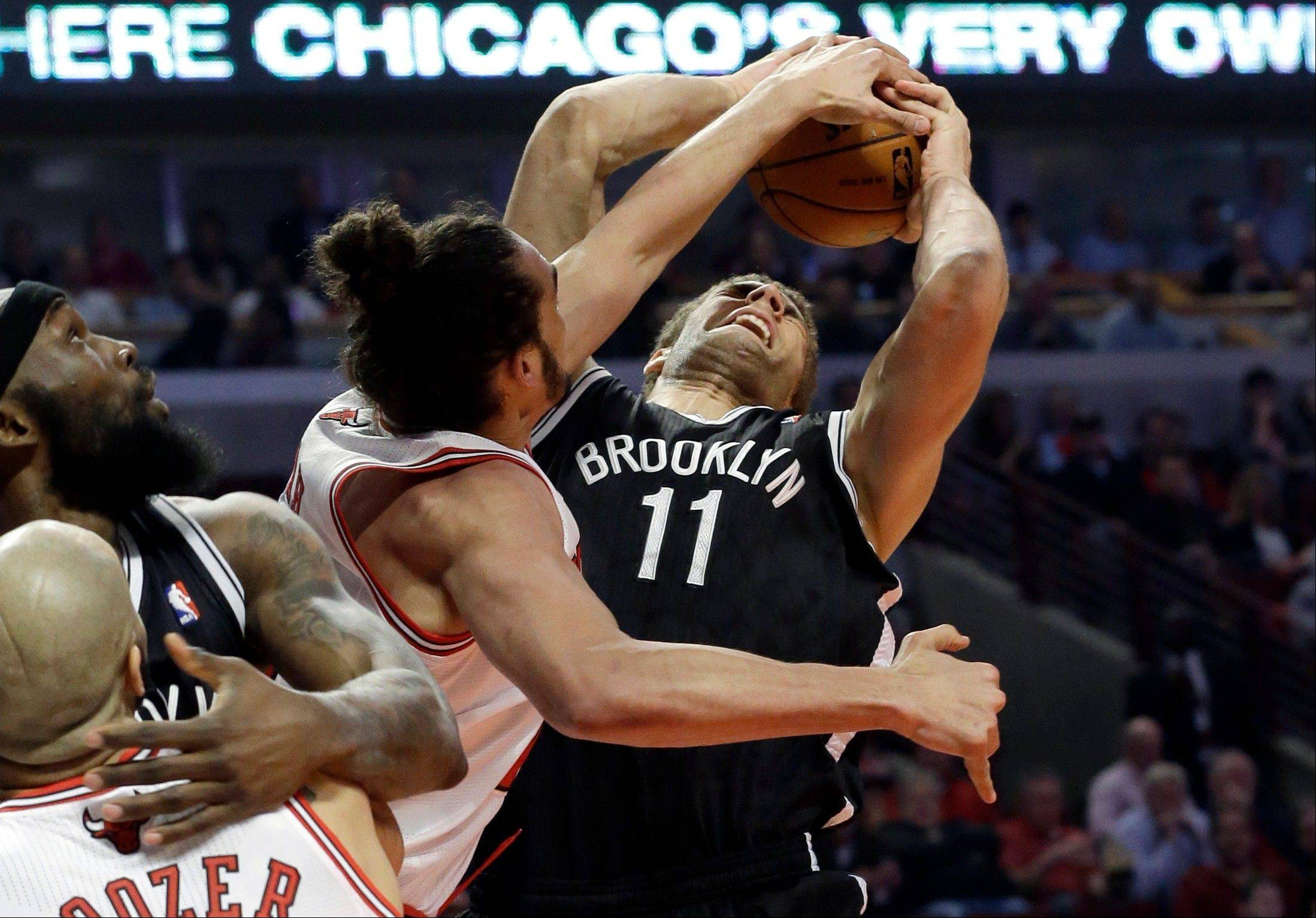 Chicago Bulls center Joakim Noah defends against a shot by Brooklyn Nets center Brook Lopez (11) during the first half in Game 6 of their first-round NBA basketball playoff series in Chicago, Thursday, May 2, 2013.