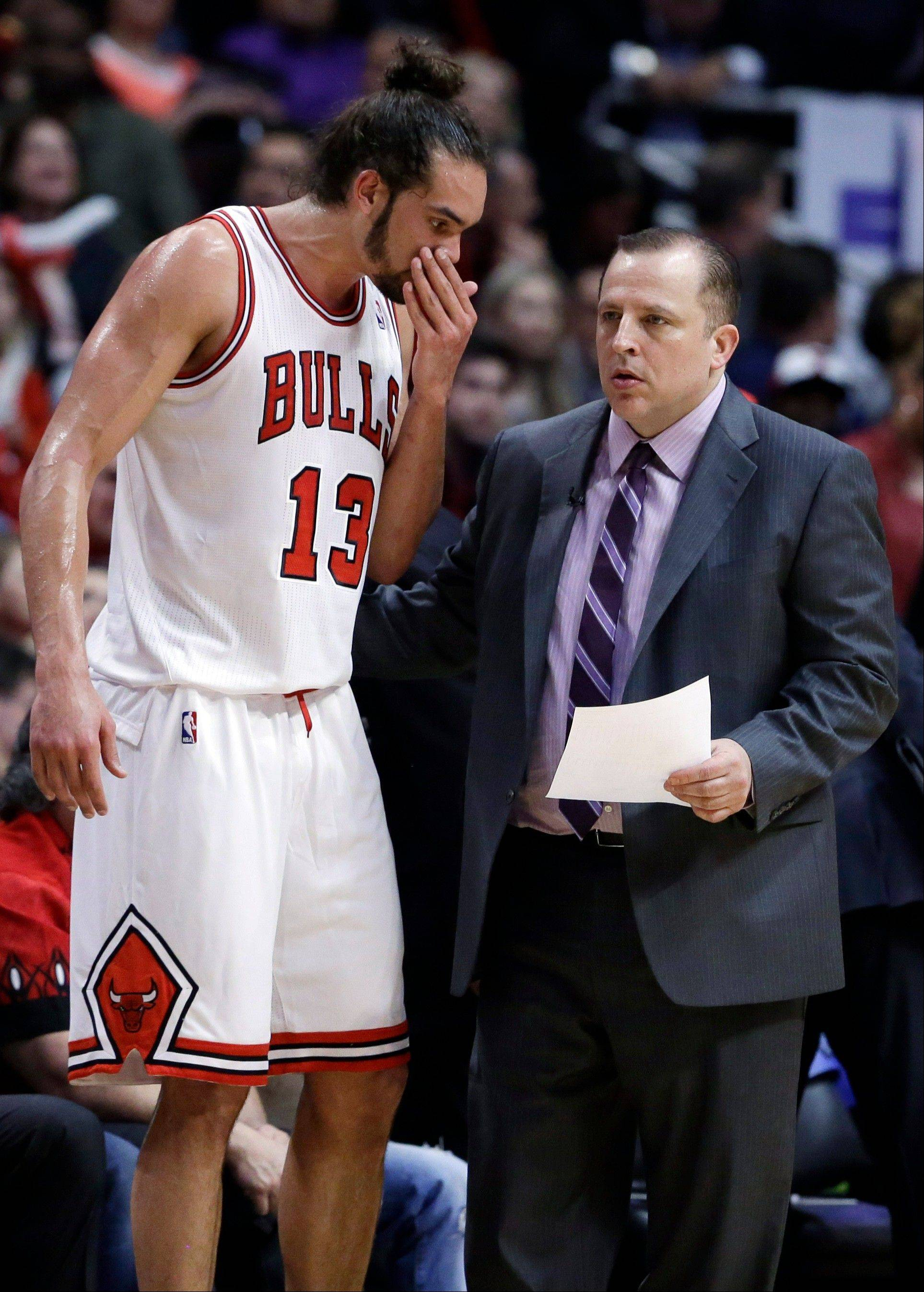 Chicago Bulls center Joakim Noah, left, talks with head coach Tom Thibodeau during the first half in Game 6 of their first-round NBA basketball playoff series against the Brooklyn Nets in Chicago, Thursday, May 2, 2013.