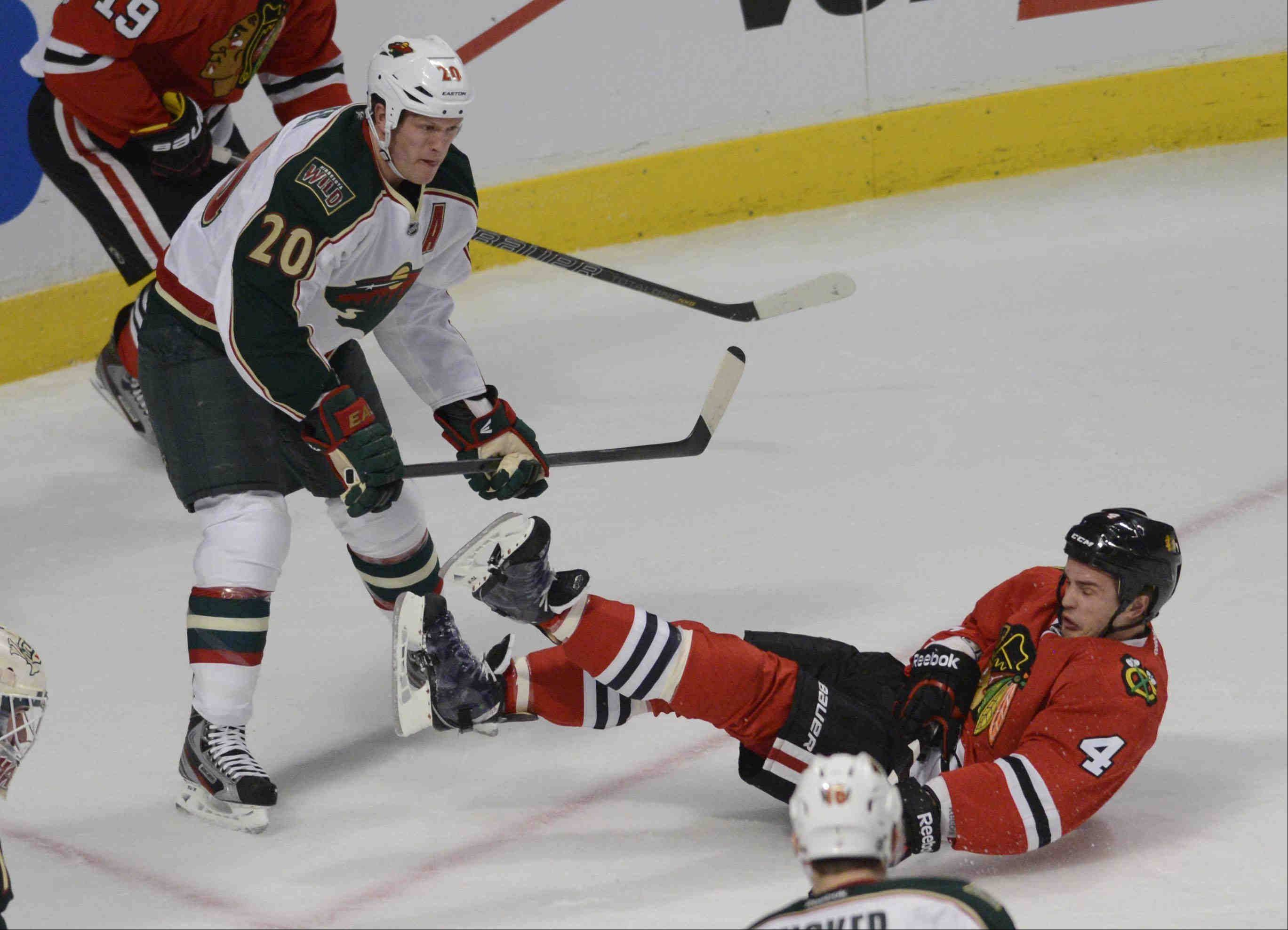 Although he got knocked off his skates here, Blackhawks defenseman Niklas Hjalmarsson and Duncan Keith had the upperhand against the Minnesota Wild's top line in Game 1, holding them scoreless.