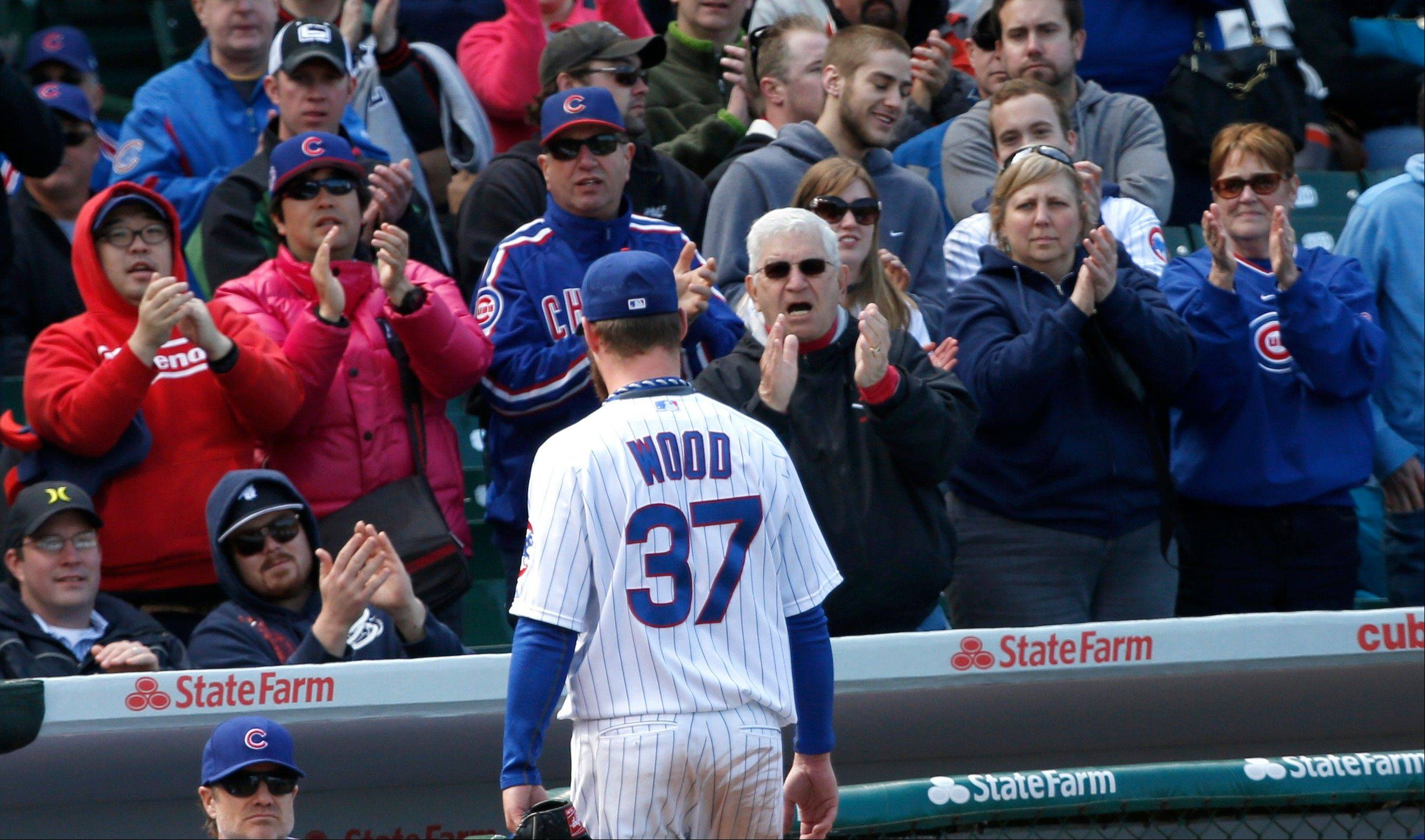 Starting pitcher Travis Wood leaves the game to applause of fans during the eighth inning Thursday. Wood shutout the Padres through seven innings, but San Diego ralied for a 4-2 win.