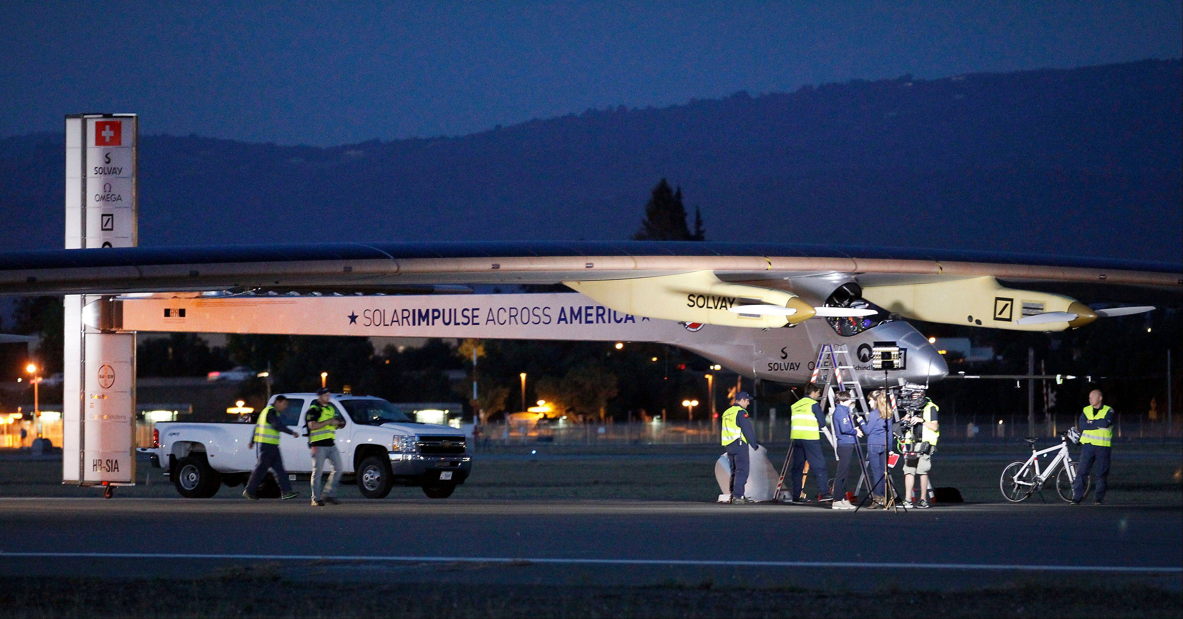 Ground crew prepares the Solar Impulse plane early in the morning Friday before taking off on a multi-city trip across the United States from Moffett Field NASA Ames Research Center in Mountain View, Calif.