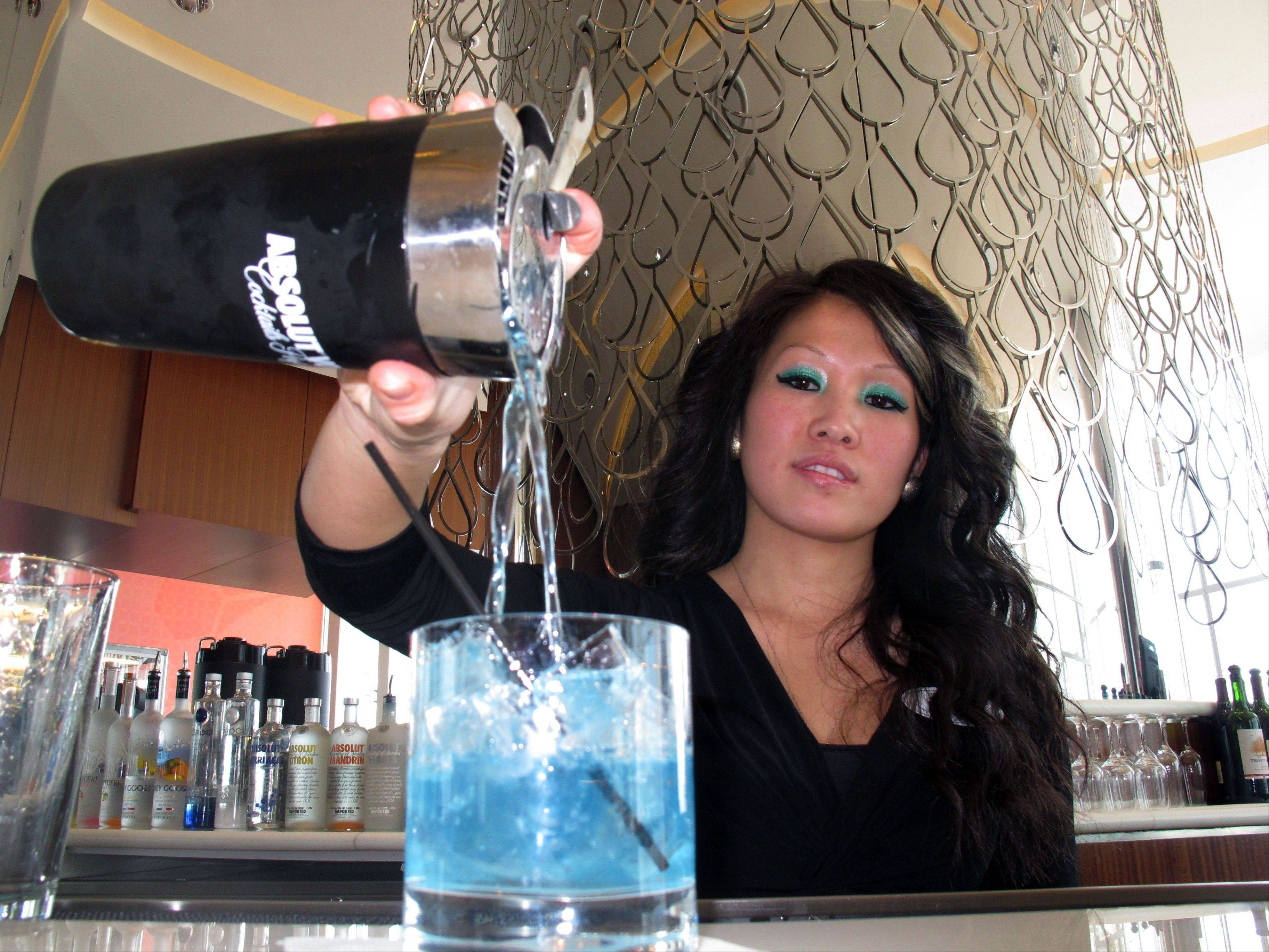 Associated Press/April 8 Mary Ma, a bartender at Revel, Atlantic City, N.J.�s newest casino, pours a drink at one of the casino�s bars. The Institute for Supply Management said Friday that its index of non-manufacturing activity fell to 53.1 in April from 54.4 in March. Any reading above 50 indicates expansion.