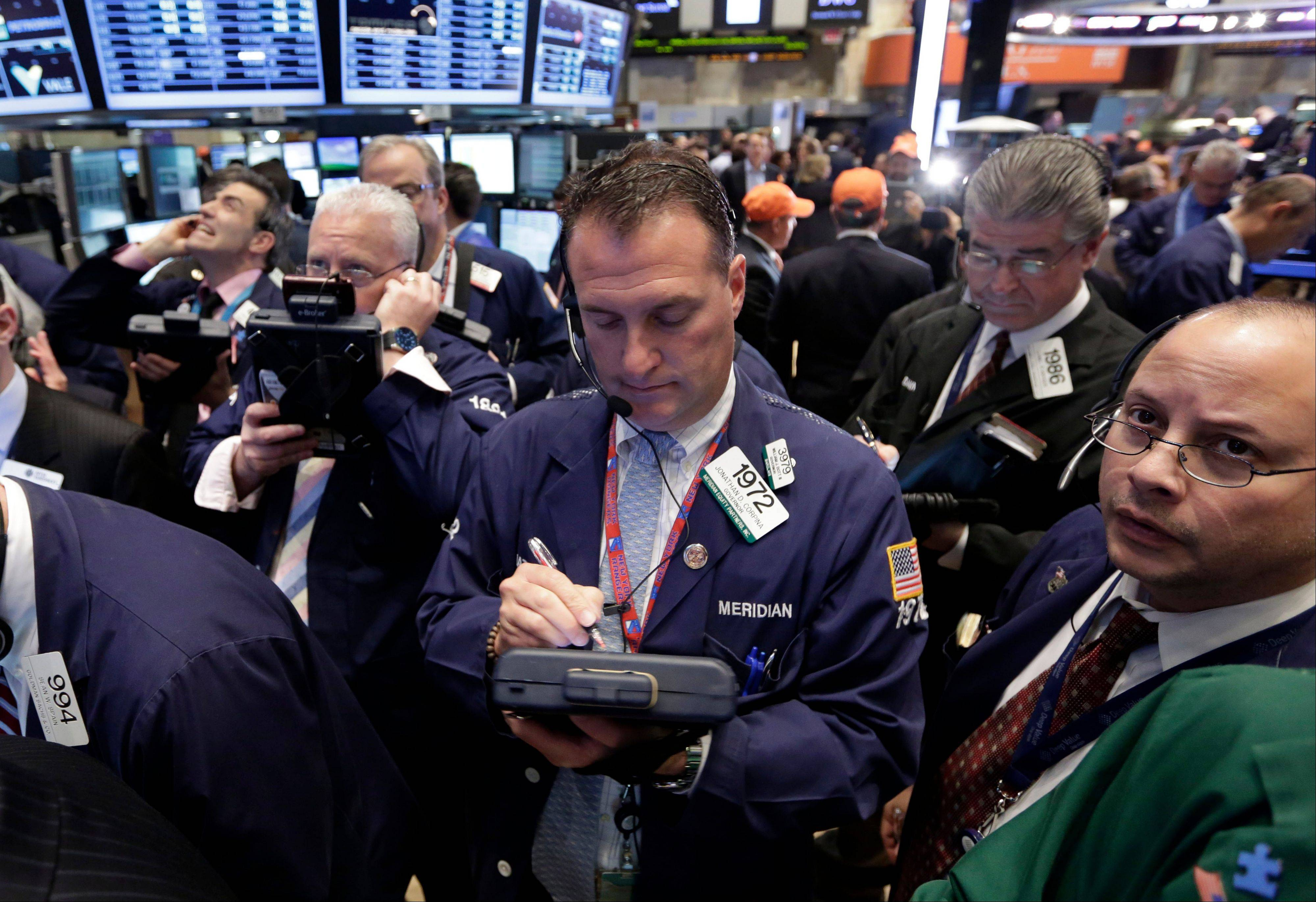 A big gain in the job market is lifting the stock market to a record high.