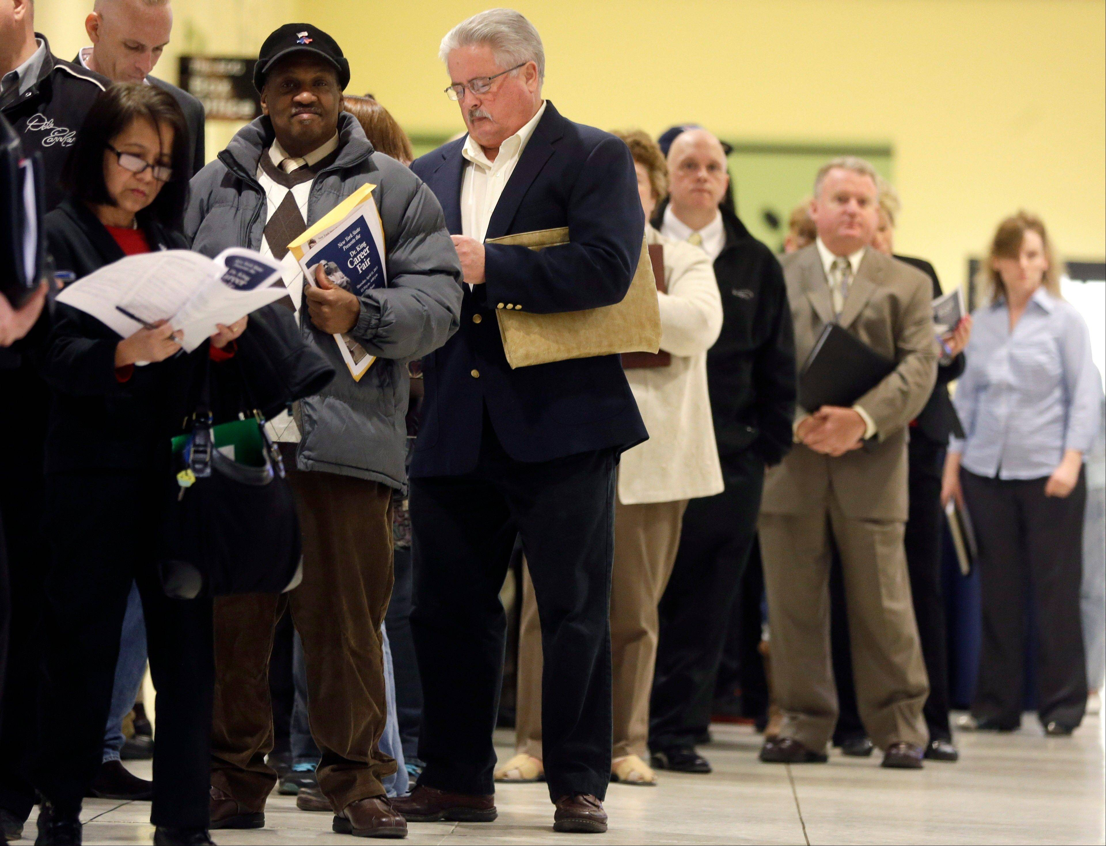 People wait in line before the Dr. King Career Fair at the Empire State Plaza Convention Center in Albany, N.Y. The government issues the April jobs report today.