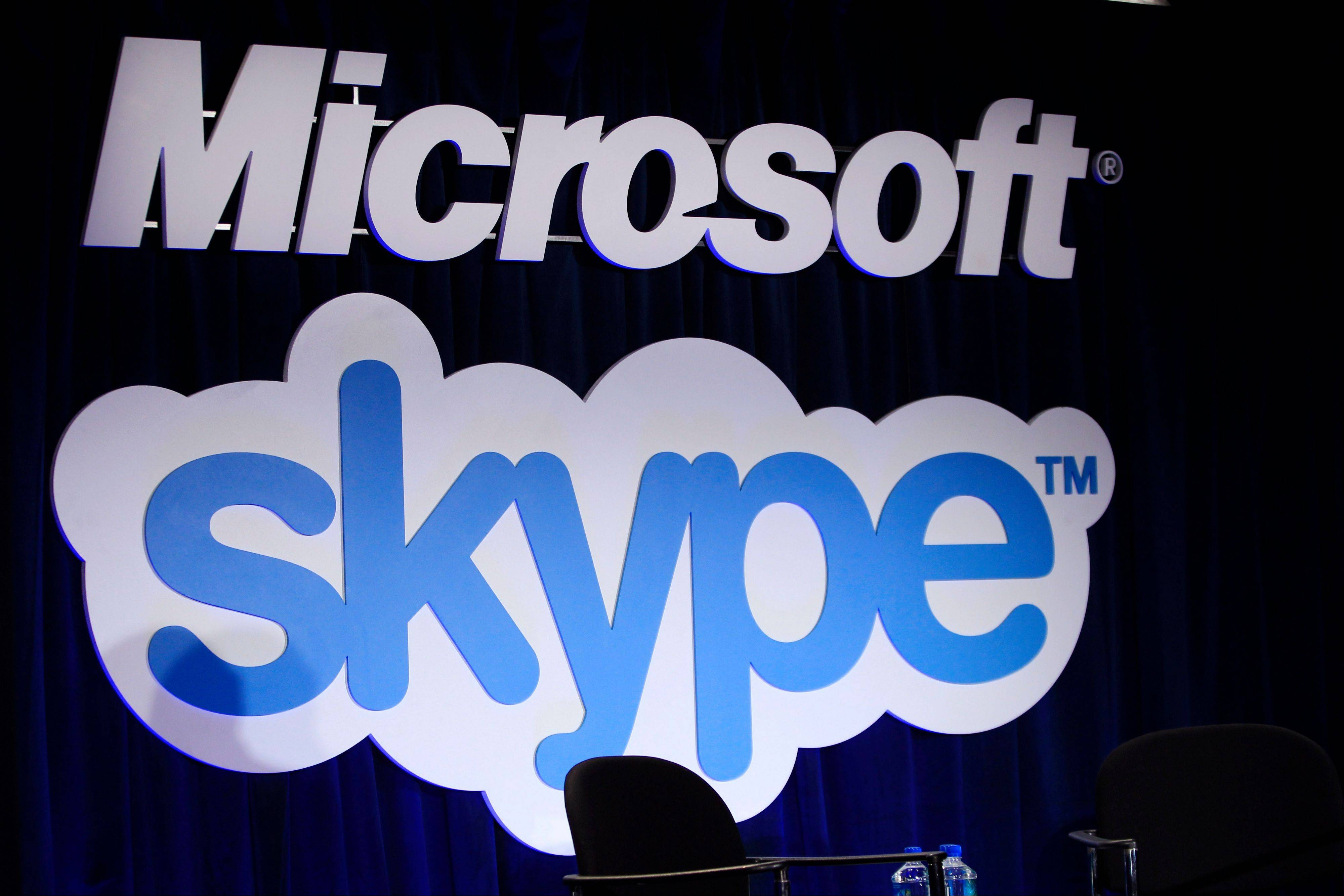 A Microsoft and Skype sign are displayed at a news conference in San Francisco.