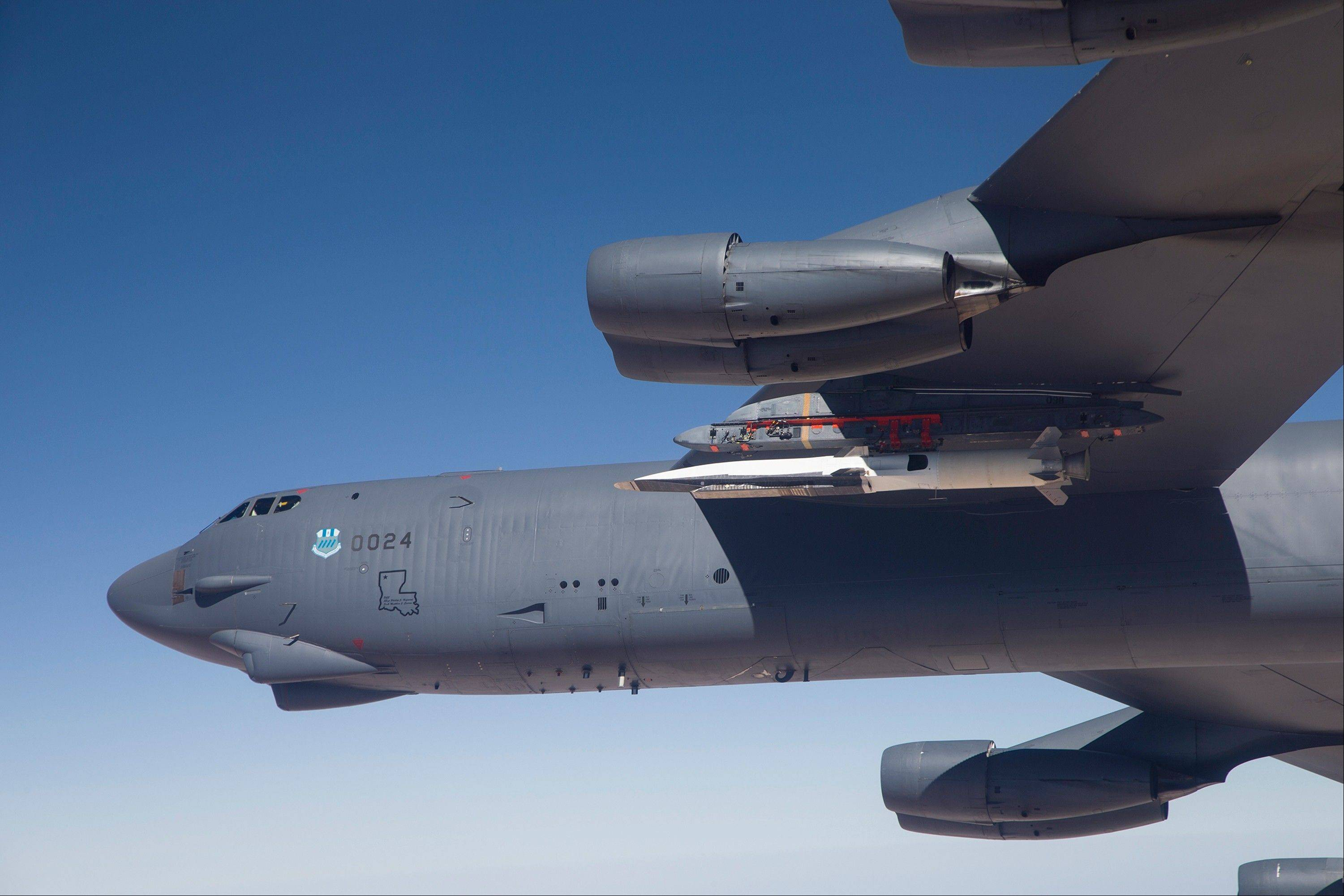 The X-51A Waverider, carried under the wing of a B-52H Stratofortress bomber, prepares to launch for its fourth and final flight over the Pacific Ocean.